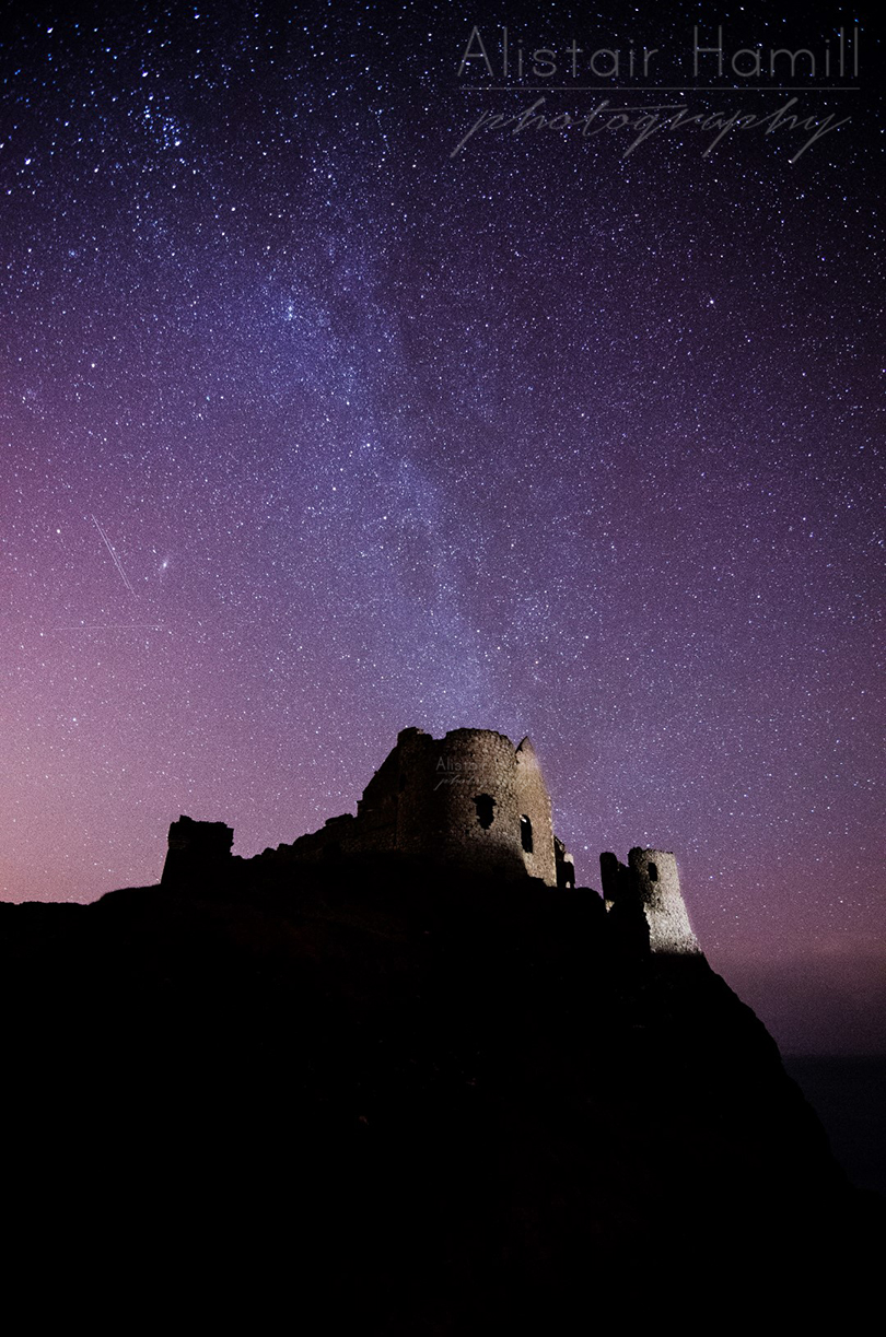 The Milky Way stretches above Dunluce - but no real aurora. Yet...