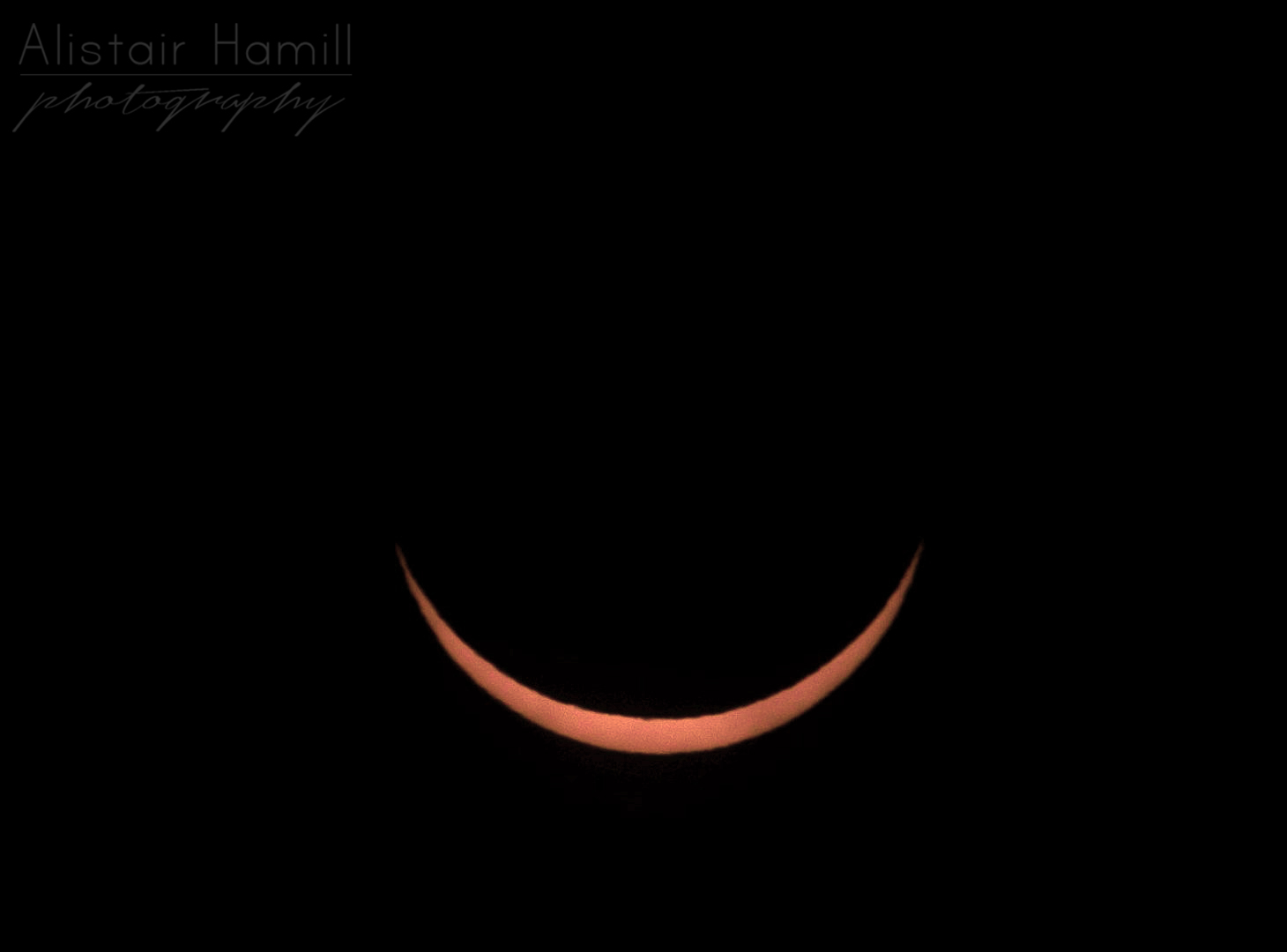 The sun at maximum eclipse, when around 93% of it was cover by the moon's disc, and the sun turned into a smiling emoji with very tightly closed eyes, by all accounts!