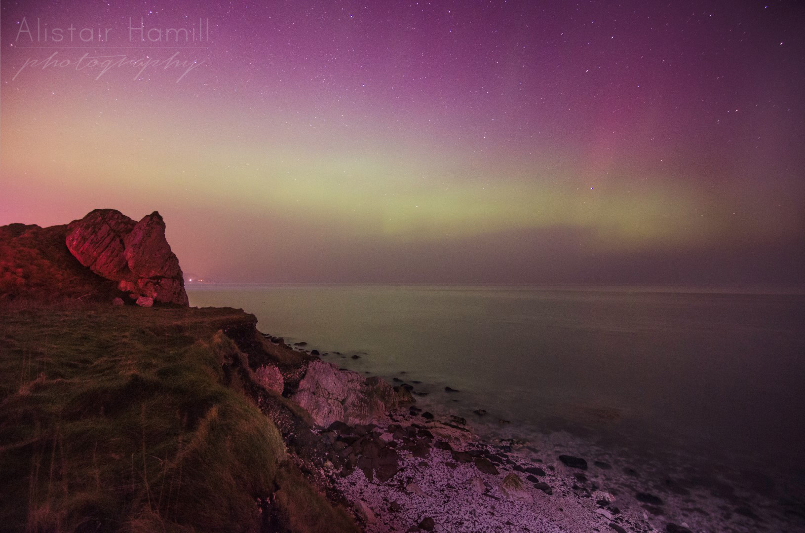 The amount of light being cast by the aurora was more than I had previously witnessed, lighting the sea and the beach before me.