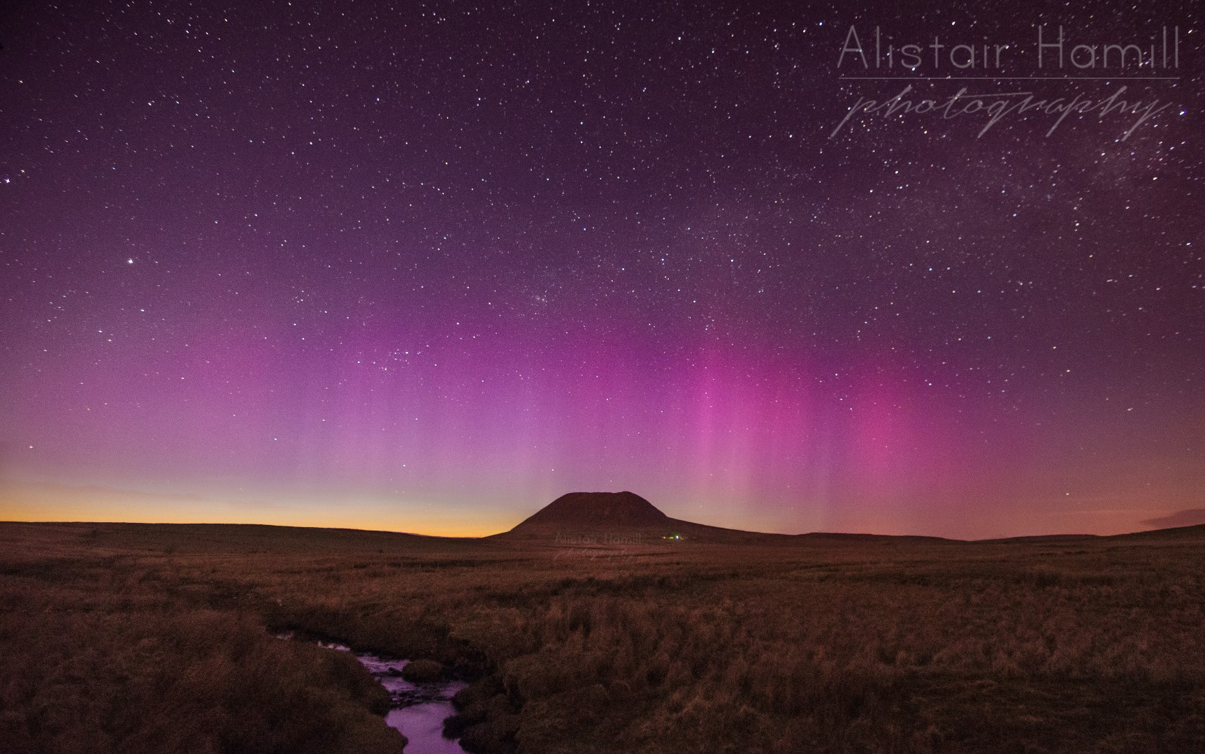 An aurora display cuts through the twilight on 12 May 2015