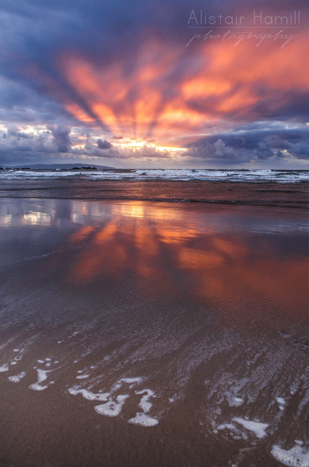 Crepuscular rays - and their reflection - at Portrush.