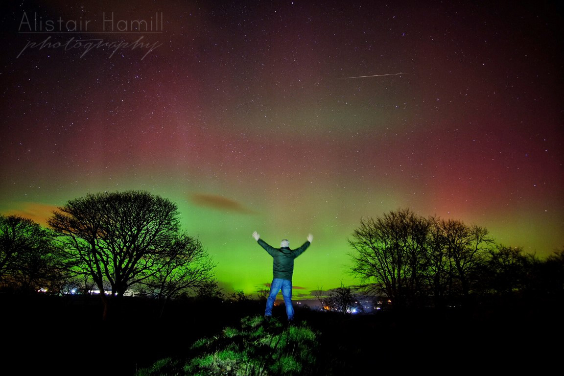 A fireball tracks across the sky whilst I am standing still for a 30 second exposure, whilst the Mother's Day aurora of 2016 dances in the sky above!