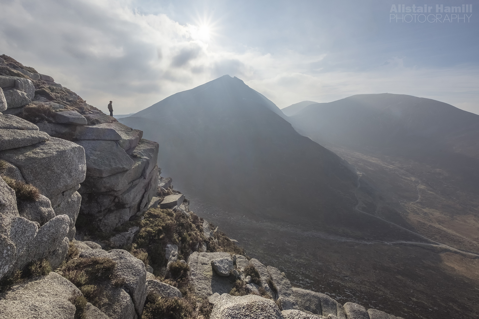 Ryan Simpson surveys Trassey Track, with the cap clouds beginning to build over Bearnagh...