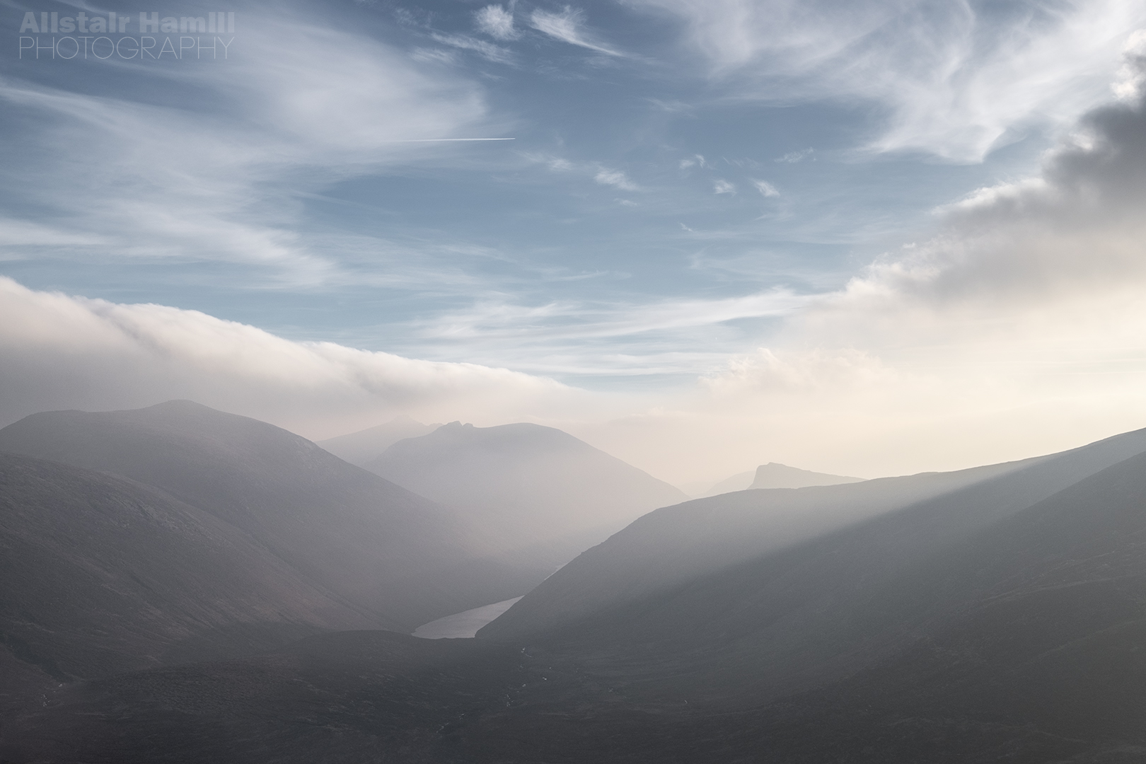 The soft light rests gently on Ben Crom reservoir