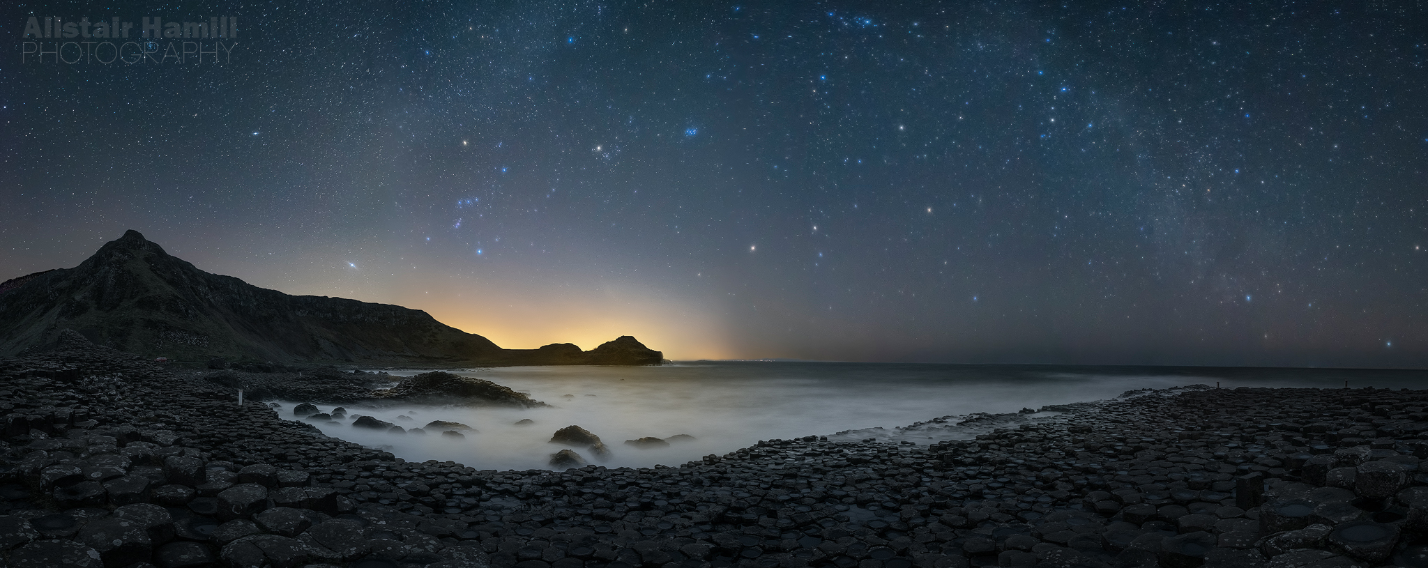 The winter Milky Way arcs above the Giant's Causeway