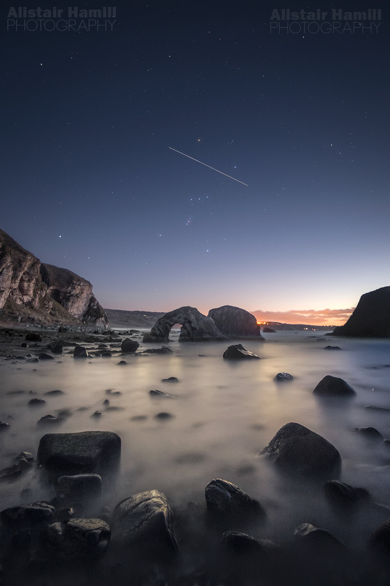 Orion over Ballintoy Arch with ISS (WM).jpg