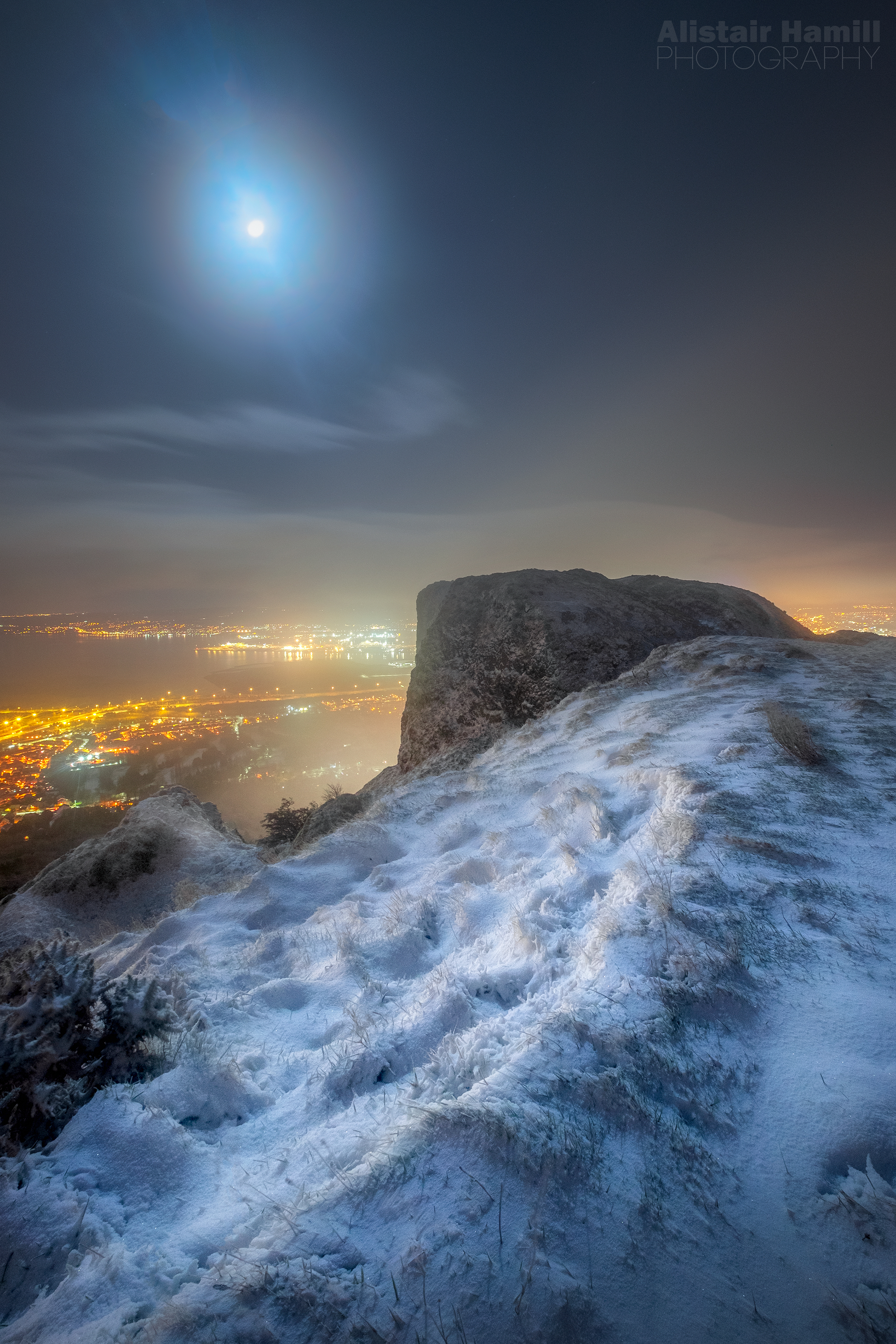 Moon glow above a snowy Cavehill