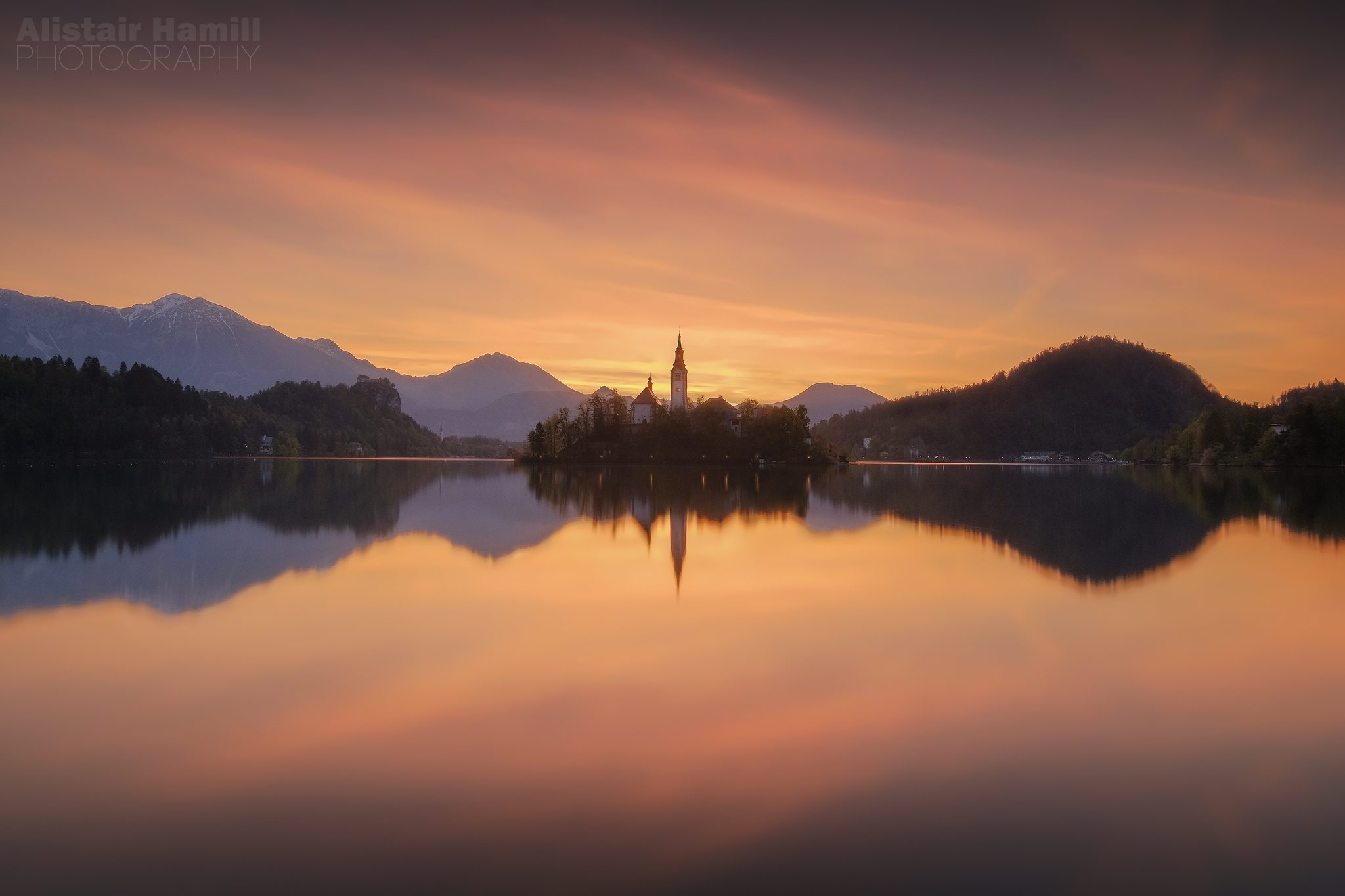 Lake Bled sunrise 1 glamor glow with lights (large) WM.jpg