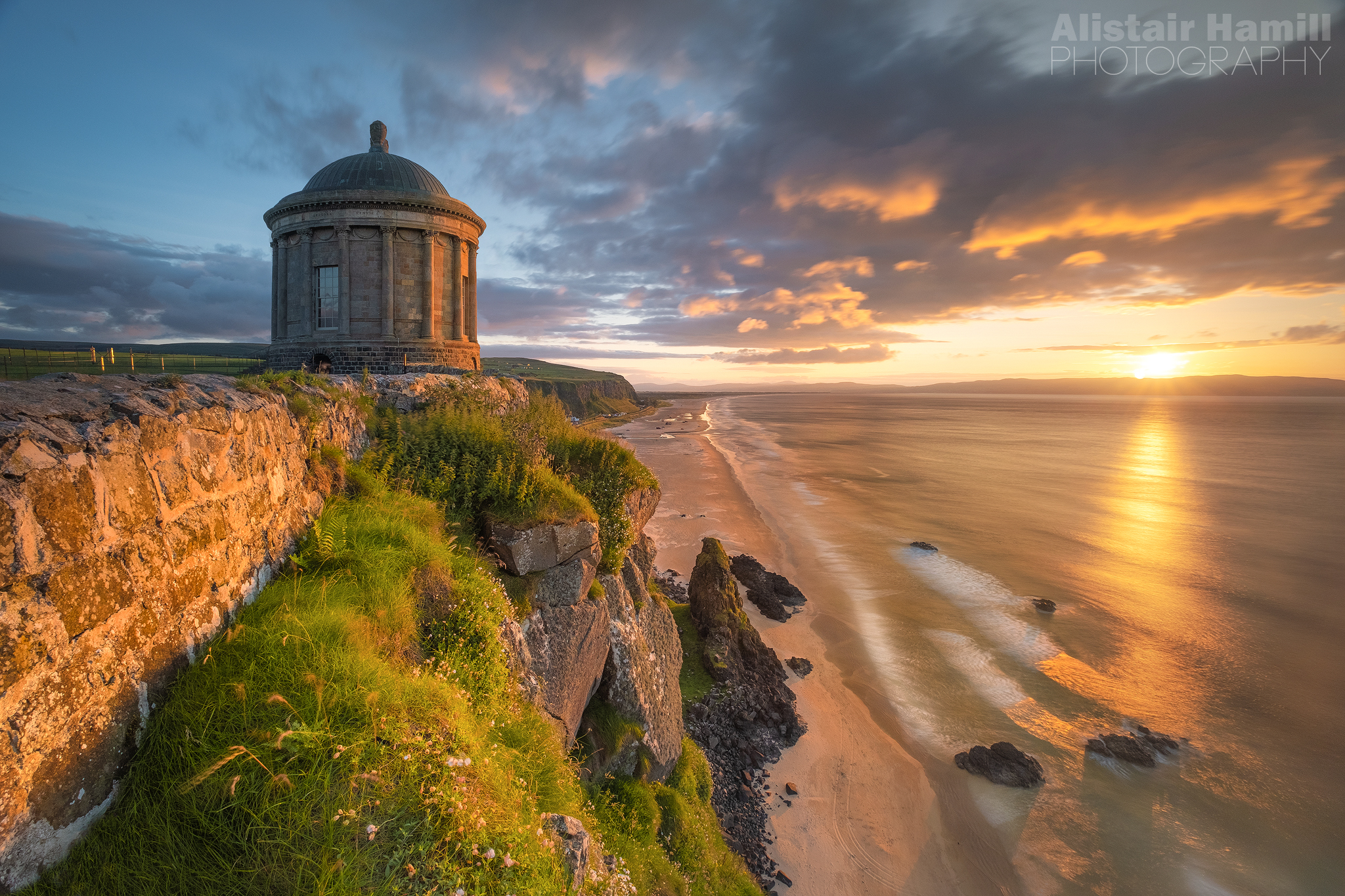 Mussenden Temple sunset with wall (large) WM.jpg