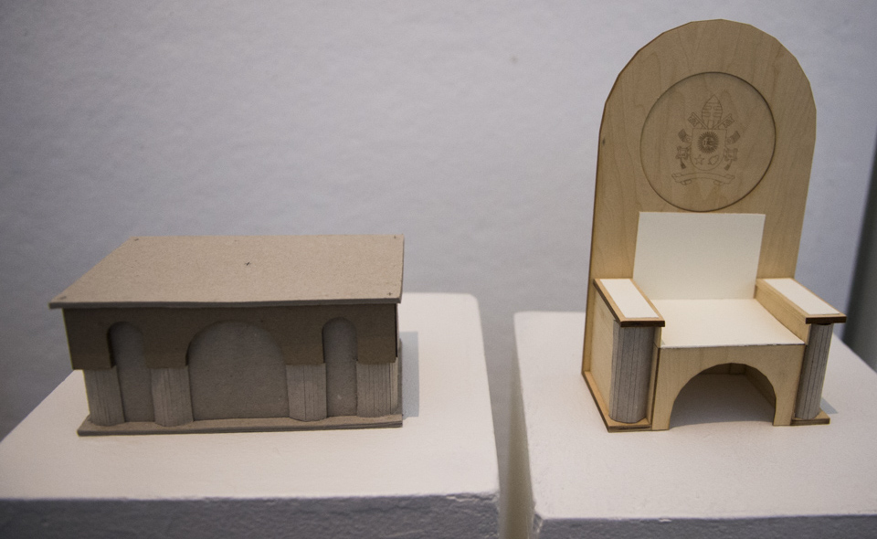"""The first-place design features arches that mimic the architecture of the Romanesque-Byzantine style Basilica. The chair designed for the Pope features a simple high arch """"designed to bring focus not on itself, but on the Vicar of Christ himself who will preach from it,"""" the team stated in their concept. Members of the winning design team include architecture students Ariadne Cerritelli (Bethesda, Md.), Matthew Hoffman (Pittsburgh), and Joseph Taylor (Eldersburg, Md.)."""