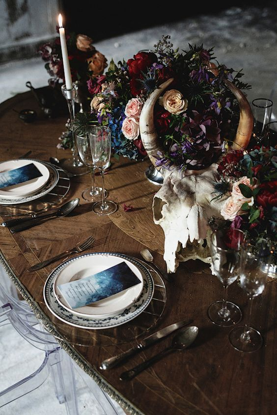 MoodyTable Setting with a Skull and Flower Centerpiece