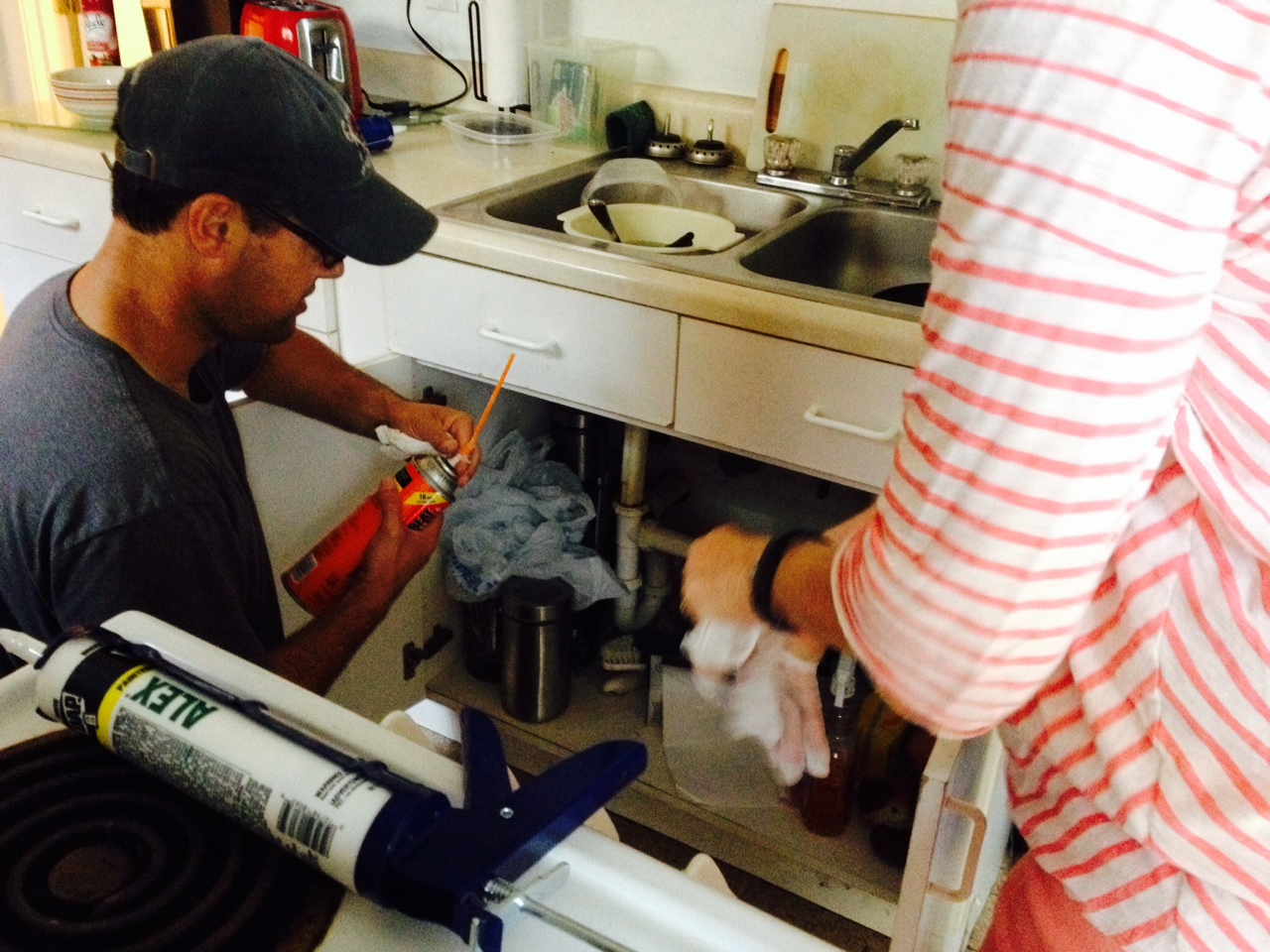 Marcus demonstrates proper air sealing for sink plumbing penetrations at the Alliance Francaise workparty.