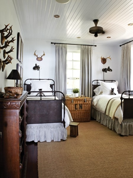 This room reminds me of adventures in the woods...what if you put the monograms of each kid on the foot of the beds.