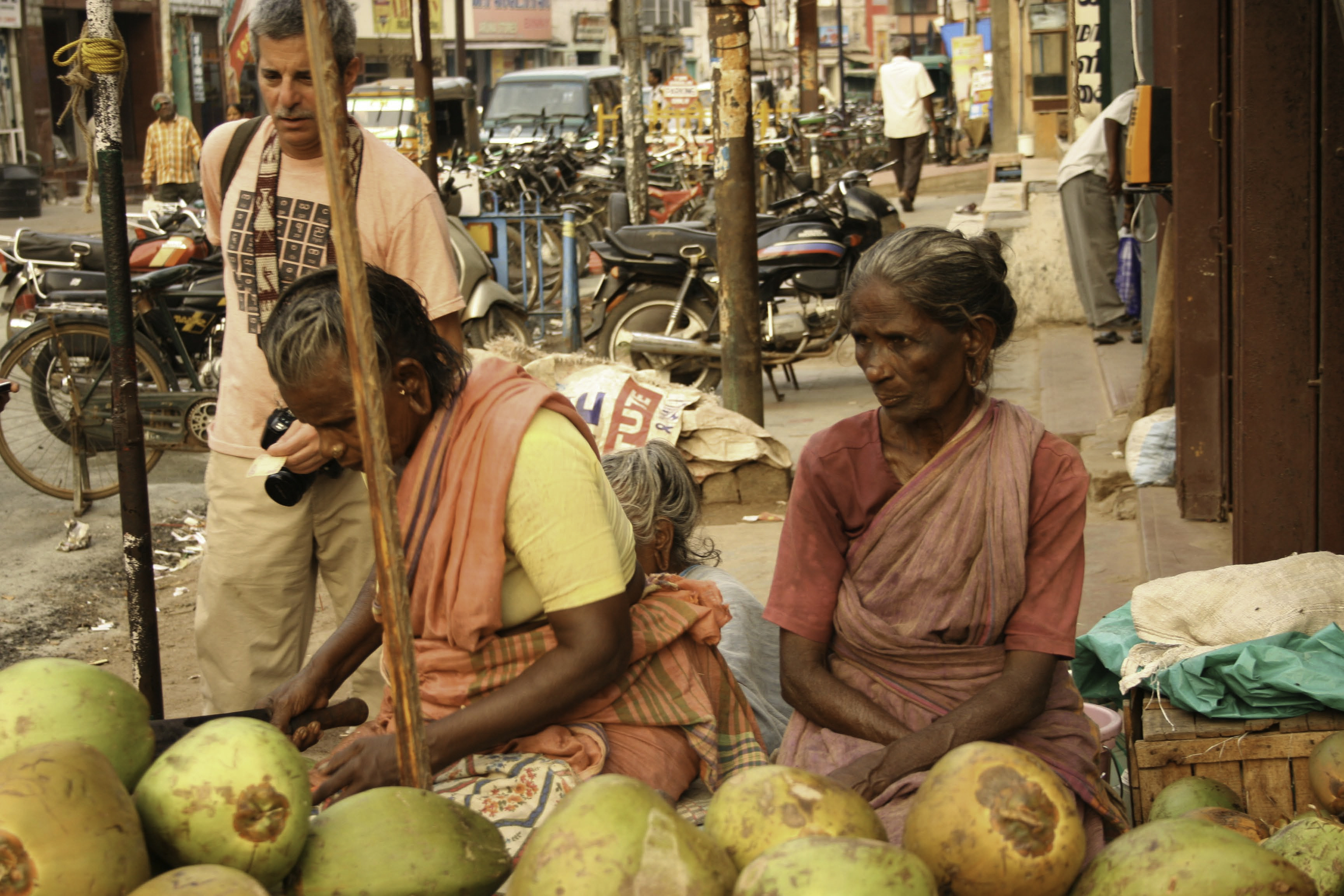 Cliff buying a coconuton the streets of Madurai