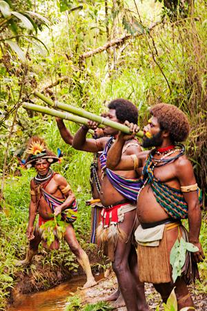 Wig_school_Papua_New_Guinea_holy_water.jpg