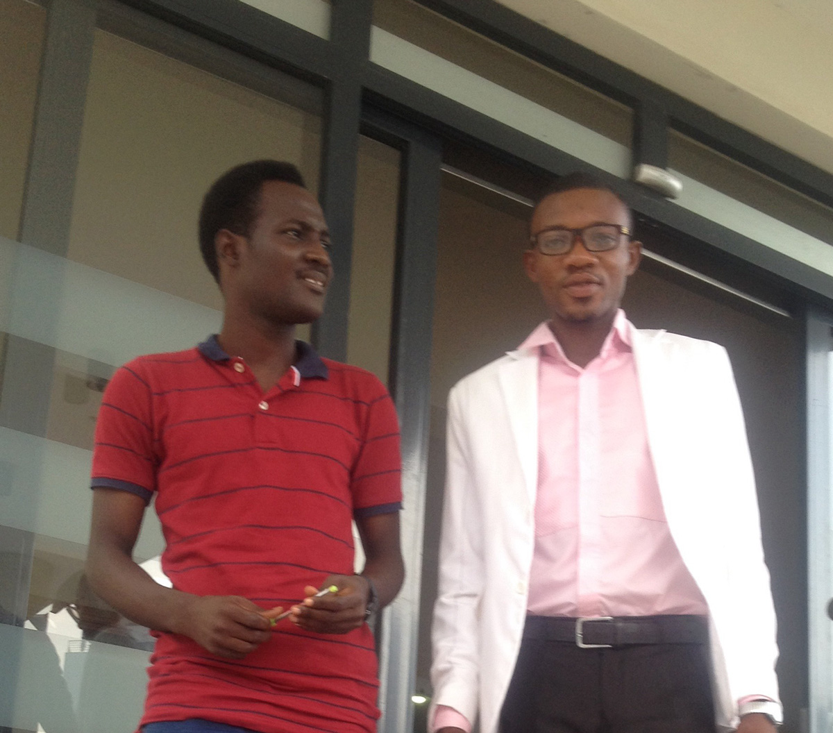 GodGift (right), with Andrew (left), the National Director of Alpha Nigeria
