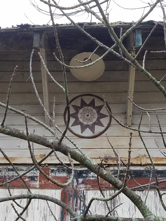 A hex sign I spotted on an abandoned building during my ride.