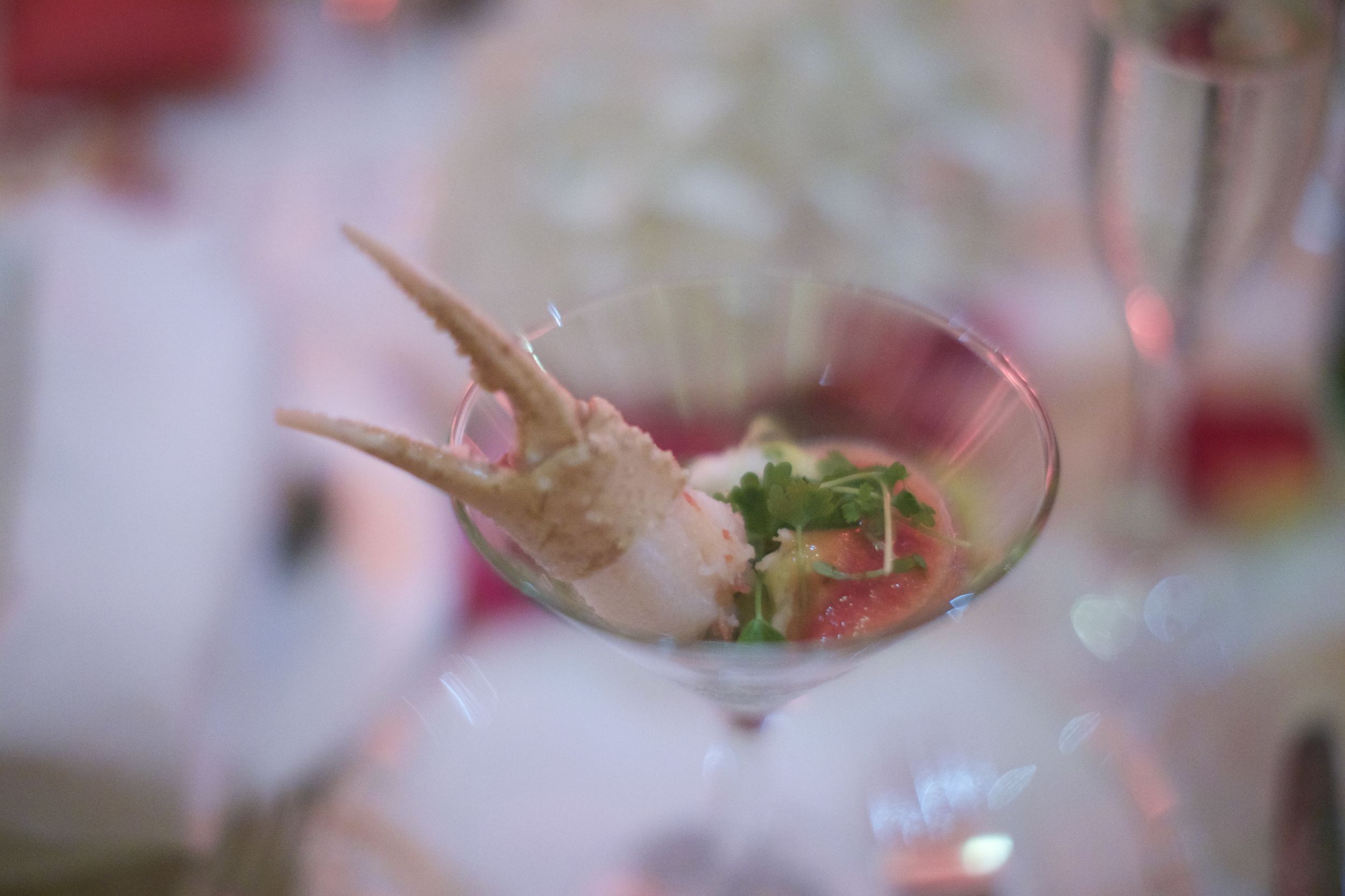 "The amouse bouche (literally translated ""amuse mouth"") was a ""Crab Martini"" and was a solid opener for the meal. In it laid chunks of dungeoness crab meat, an avocado puree or ""Mousse"", and a ""Blood Mary"" tomato based condiment of sorts. Although I did miss the ""Foam"" effect of the the ""Bloody Mary"" sauce.  Here's how the menu read:                                                                       -Amuse bouche-                                                                       Crab Martini                                       Lump Crab/ Avocado Mousse/ Bloody Mary Foam"