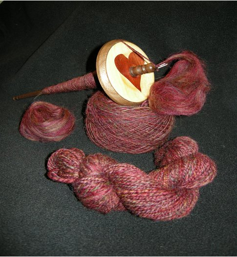 Clockwise, from left:  Ashland Bay Colonial Top, Kundert spindle resting on singles of unknown WPI, my first finished 2-ply.