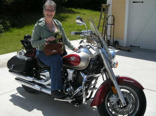 Monica modelled her new purse, seated on her motorcycle
