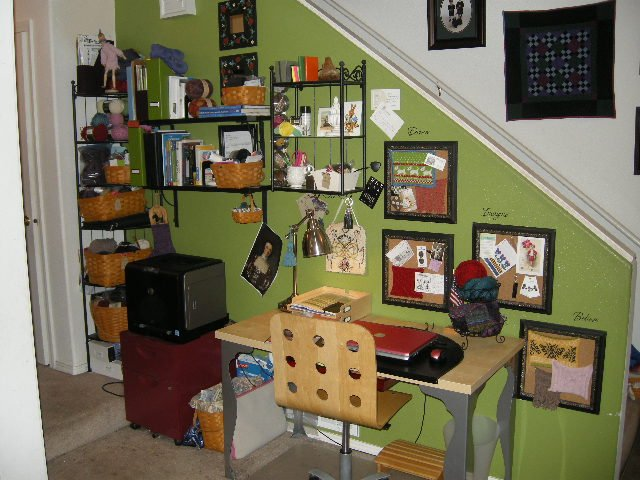 My desk, surrounded by tack boards and baskets of, what else? YARN! Notice how the simple act of painting the wall behind my desk delineates the space and makes it special?