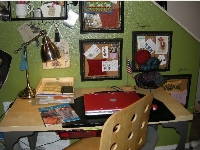 Here's a closer look at my desk. Swatches, postcards, buttons I love, and other inspirational ephemera are all here in a rotating display that keeps me inspired, or at least tenacious. In the foreground issome artwork from my book,   The New Stranded Colorwork
