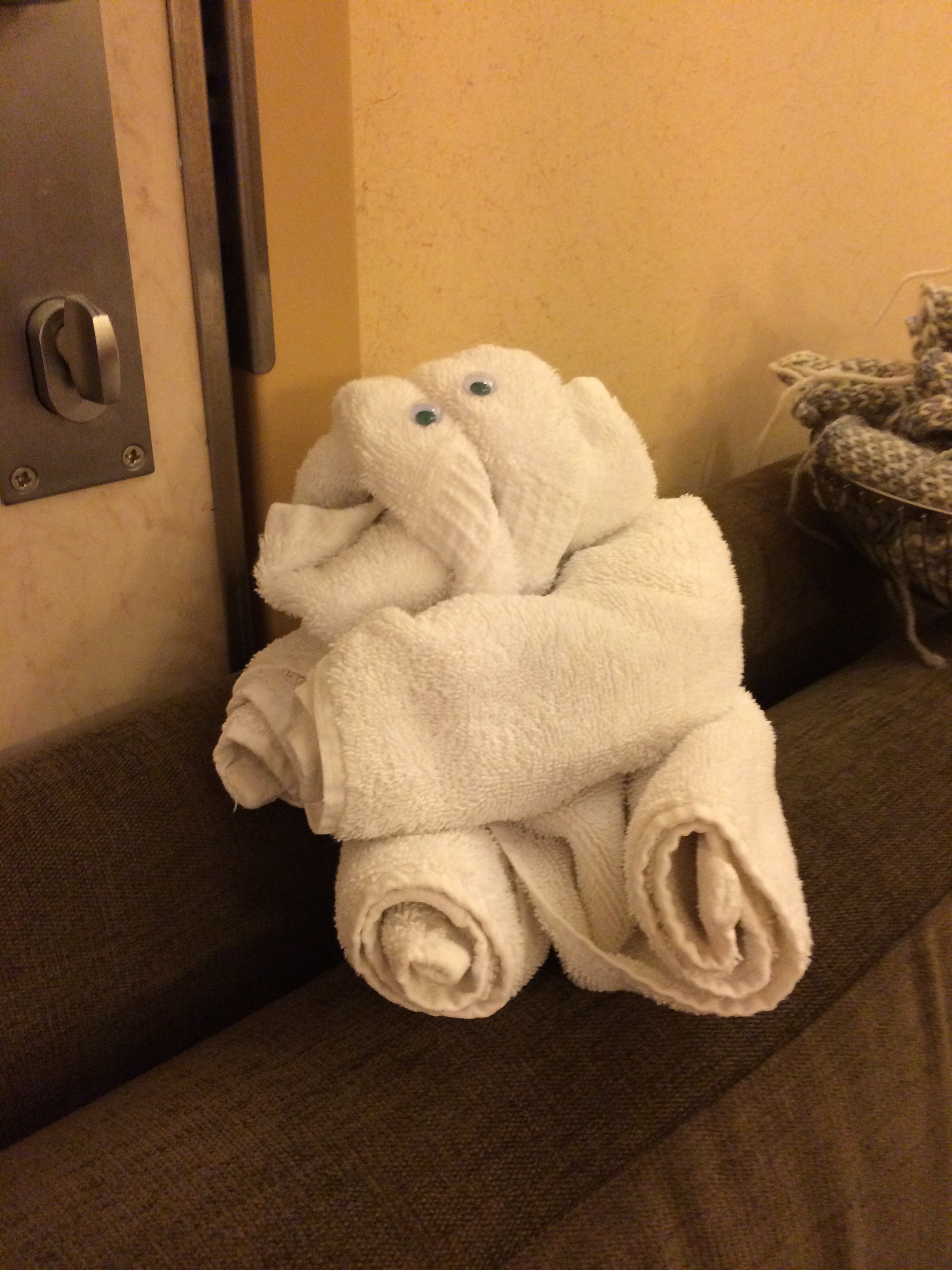 A towel elephant, by Rozy keeps a pile of steeking swatches company.