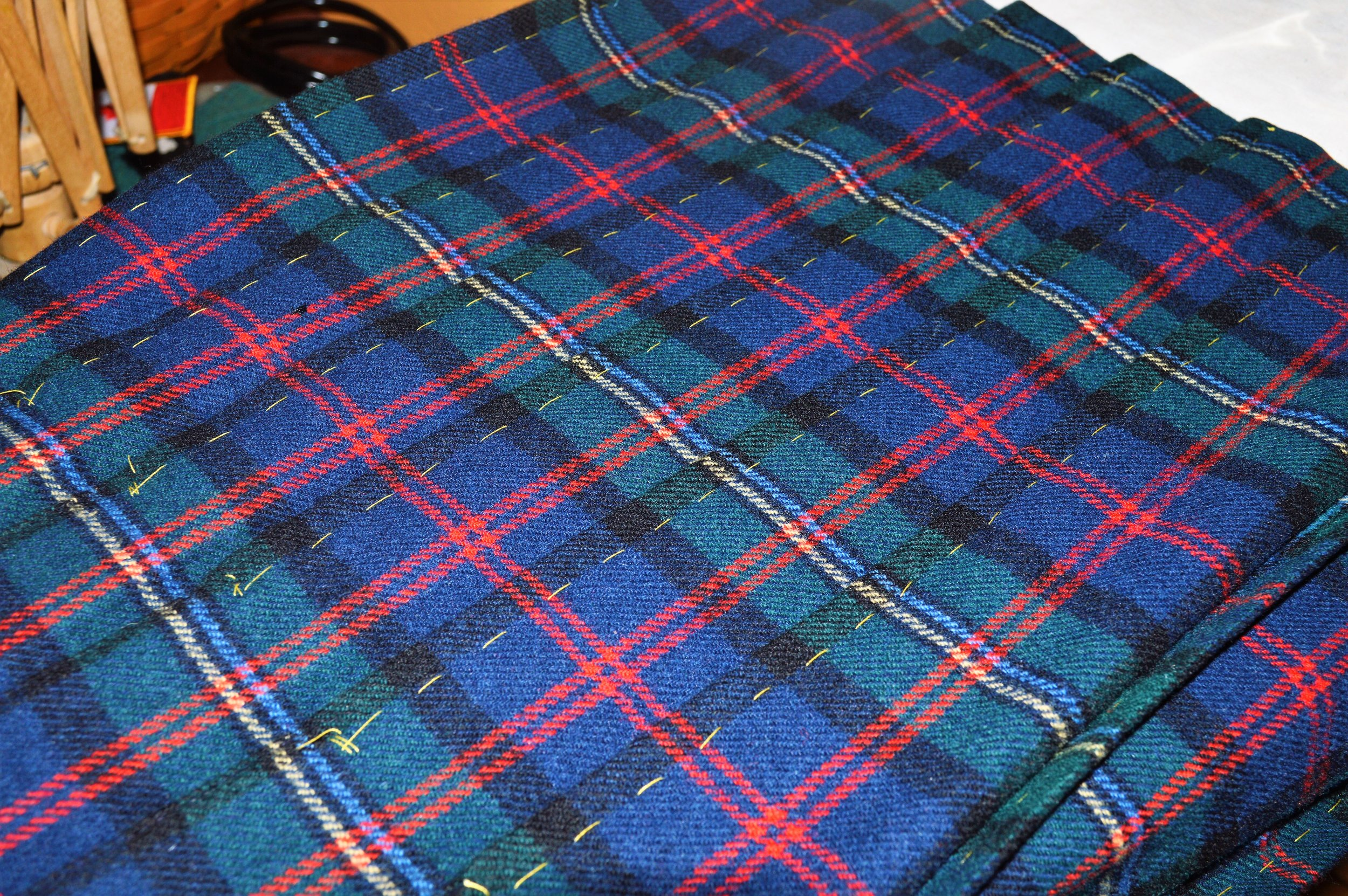 Pleats held in place with basting stitches on the right side