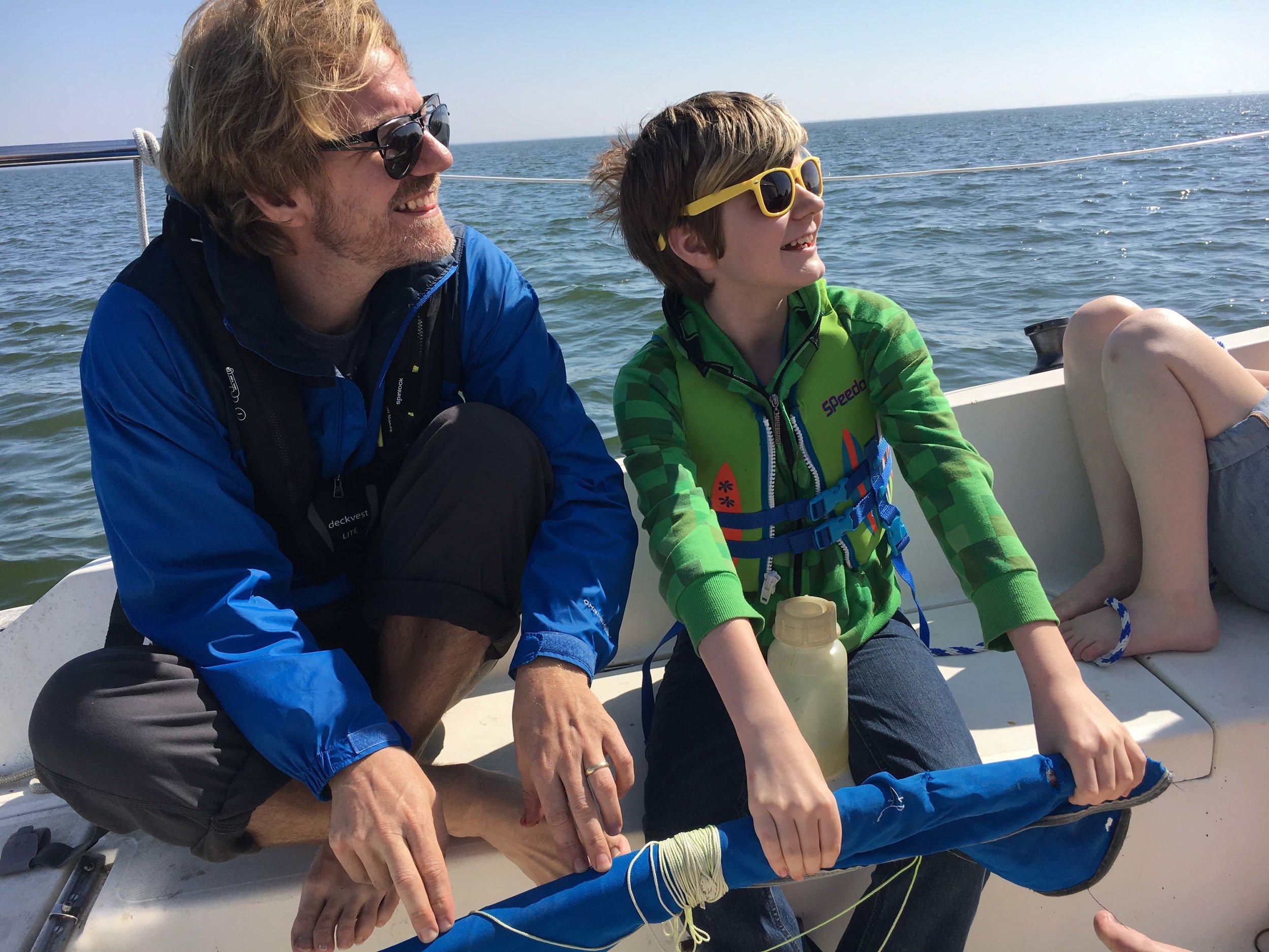 Eli's enjoys sailing more when he has the tiller