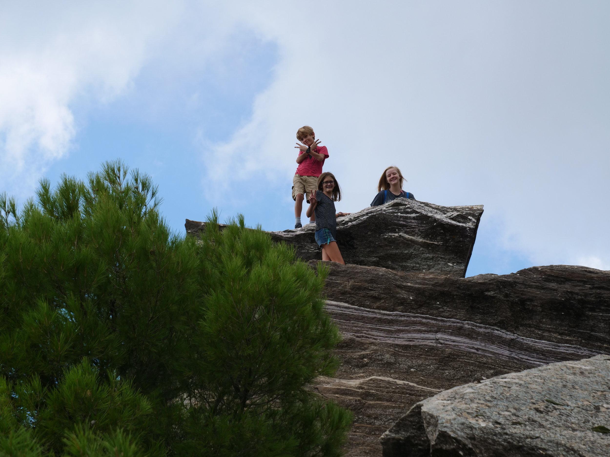3 kids on rock.JPG