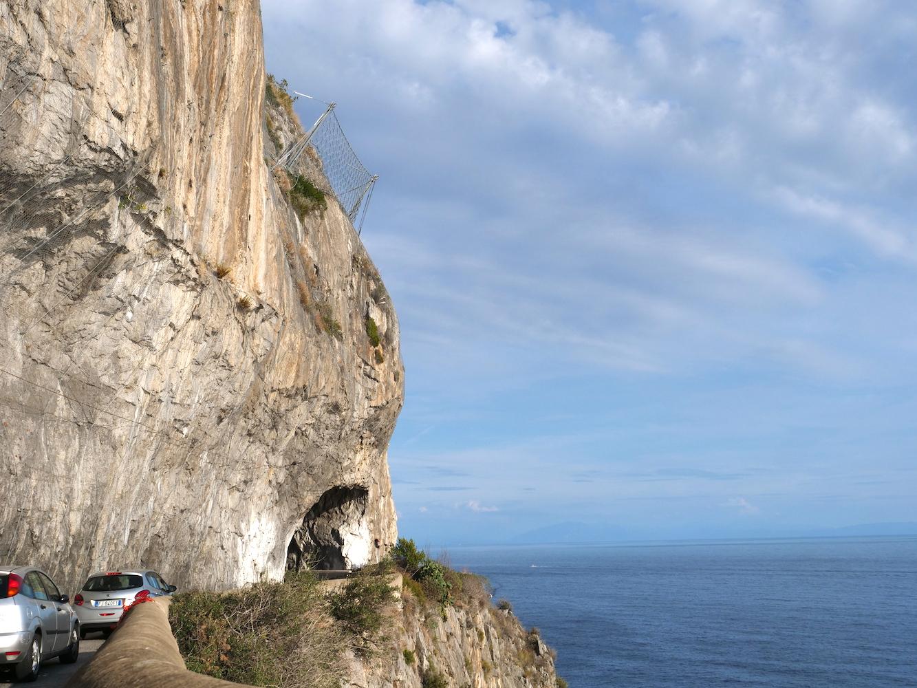 Cutting into a cliffside tunnel on the Amalfi Coast.