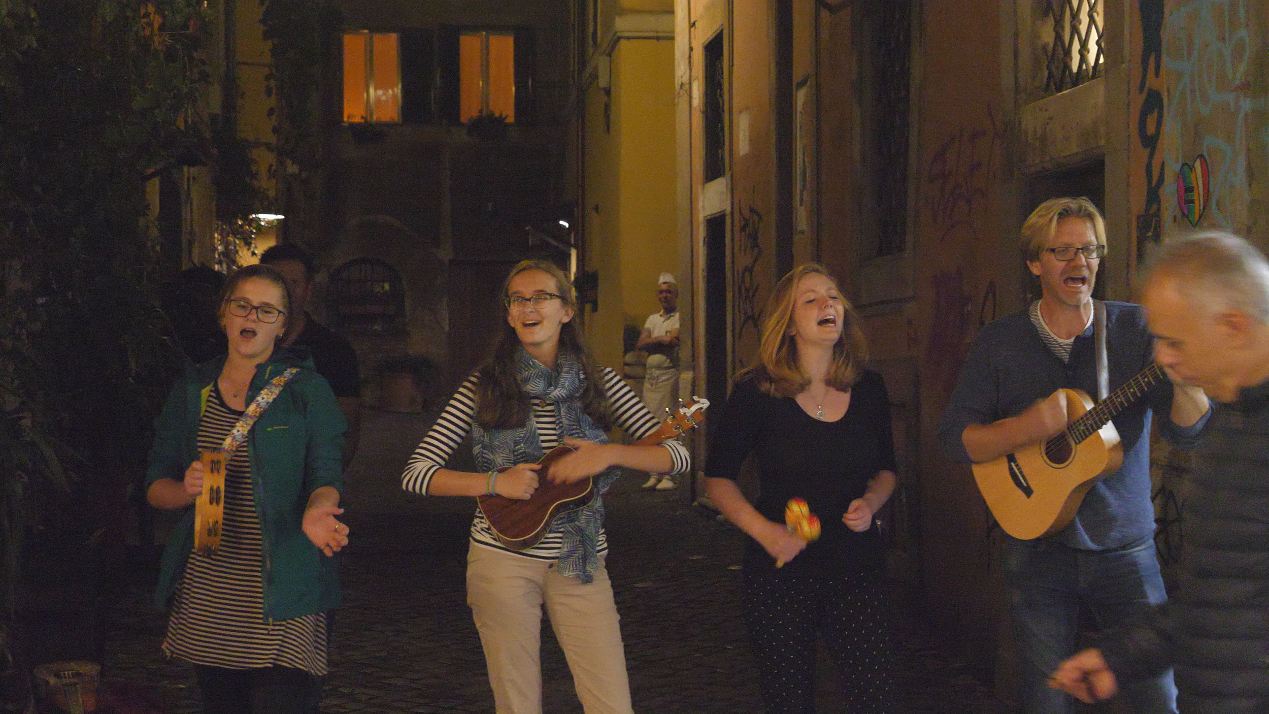 Erik & Sons busking in the Trastevere neighborhood in Rome. (L to R: Jaci, Kate, Alison & Erik)