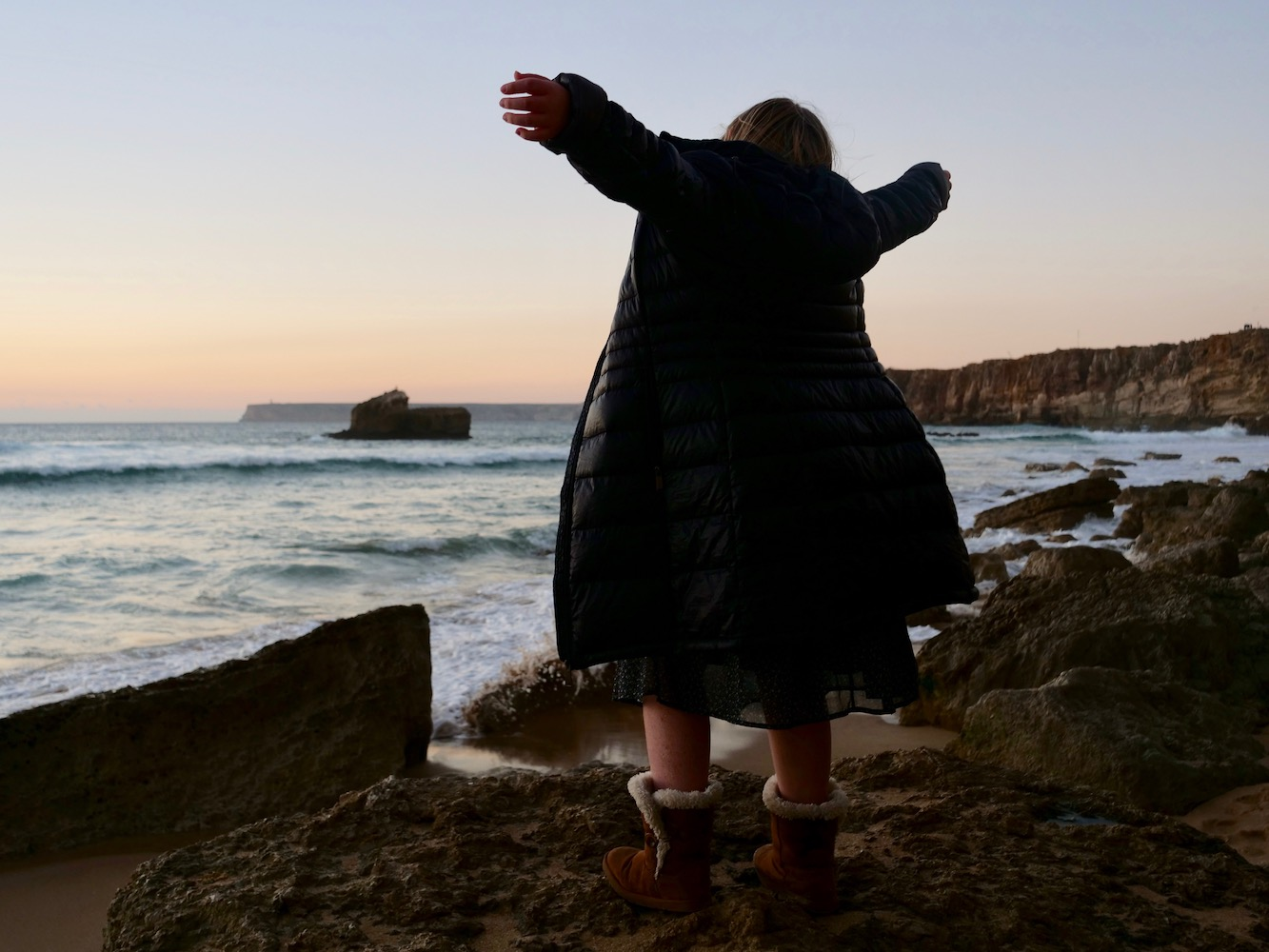 """Lily in Sagres, the southwestern coast of Portugal. Before Columbus, this was the edge of the """"known world"""" as far as Europeans were concerned. A perfect spot for reflecting back and looking forward."""