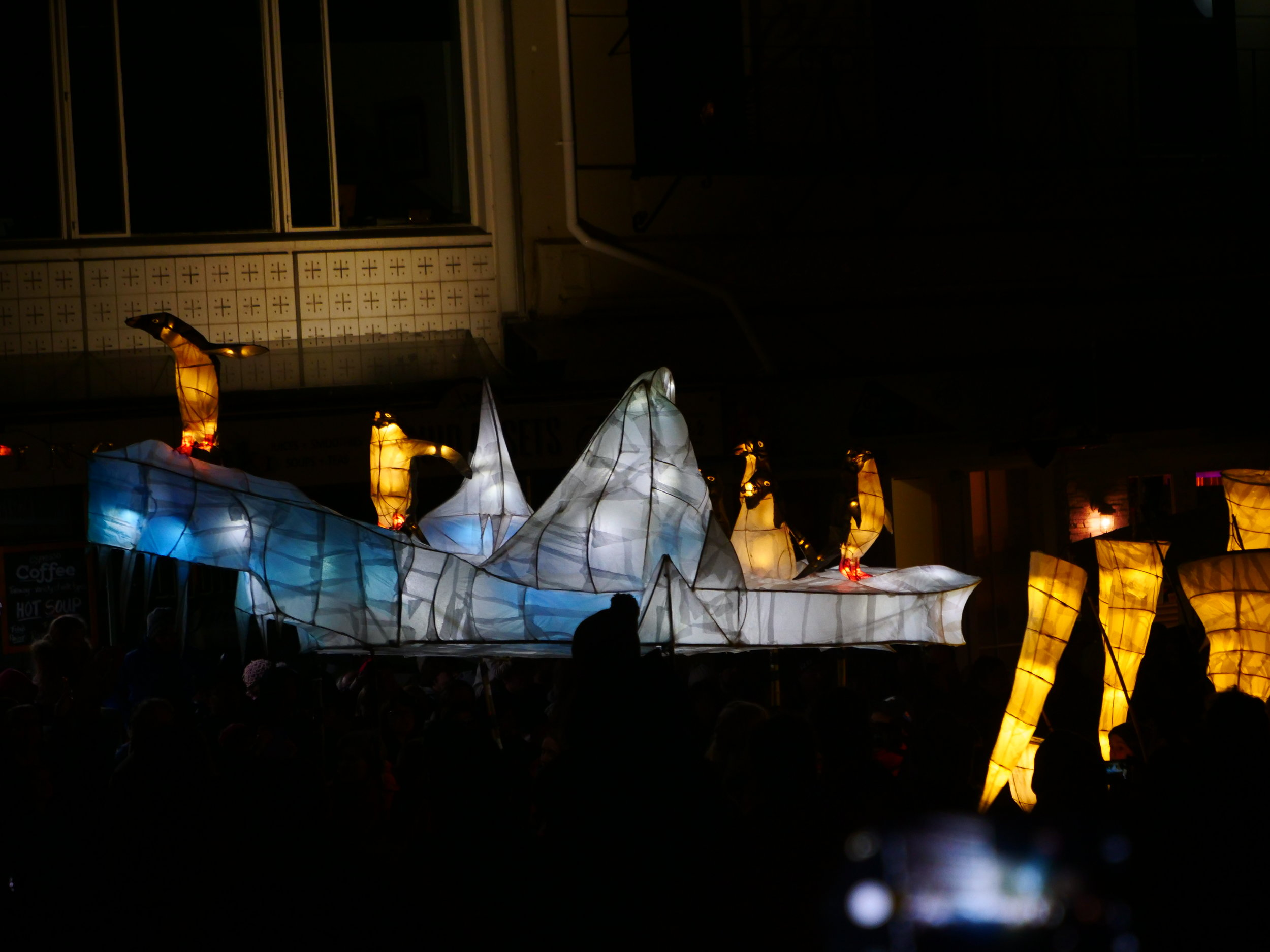 Icebergs and penguins make their way around the center of Dunedin in the Midwinter parade.