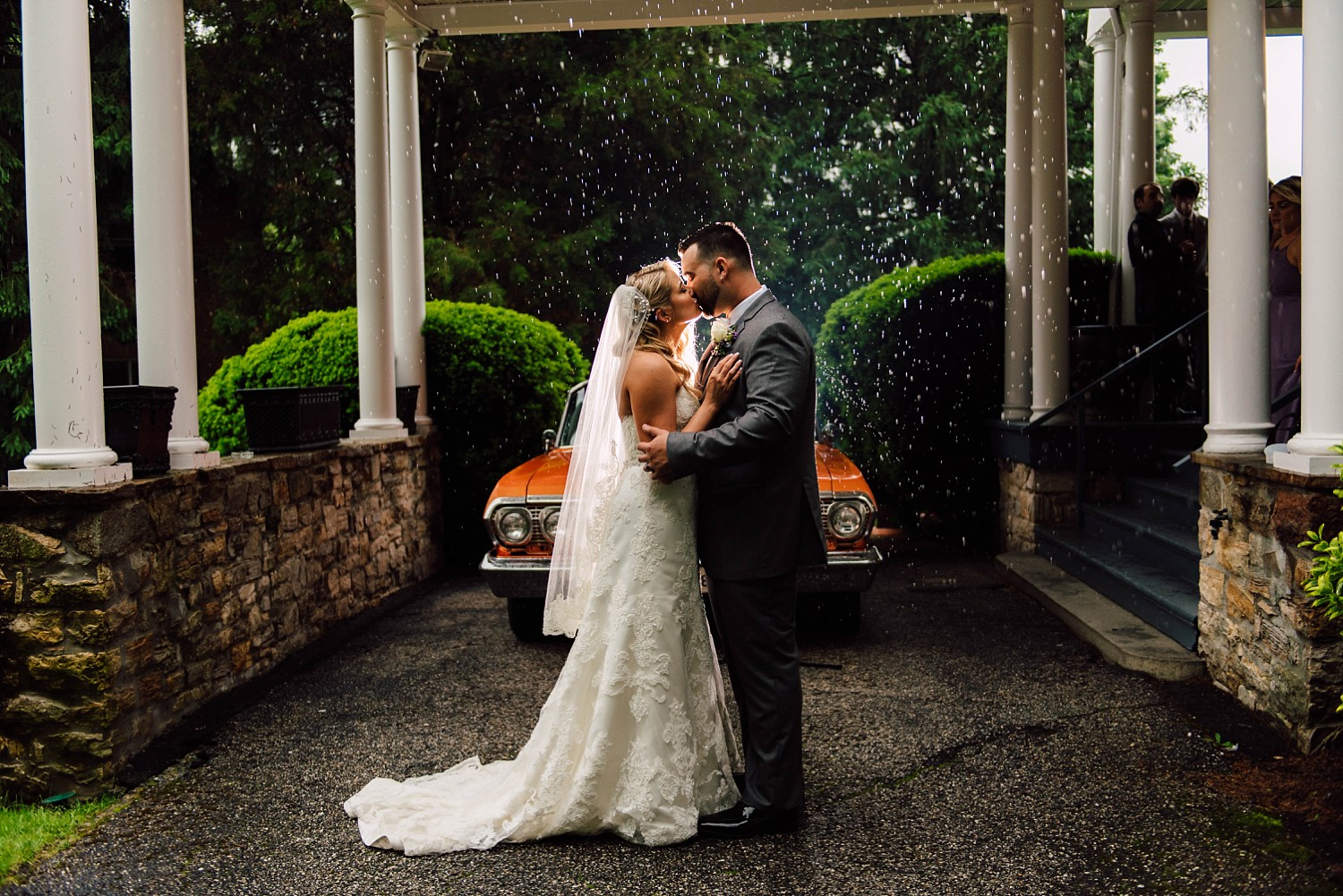 Was able to get this portraits of Travis and Amanda right before the reception. I know how special this car means to Travis and so we had to get a portrait in front of it. With it raining on their wedding day we were able to take advantage of it! creating something beautiful and artistic that would not otherwise be available on a sunny wedding day. #MakingLemonade