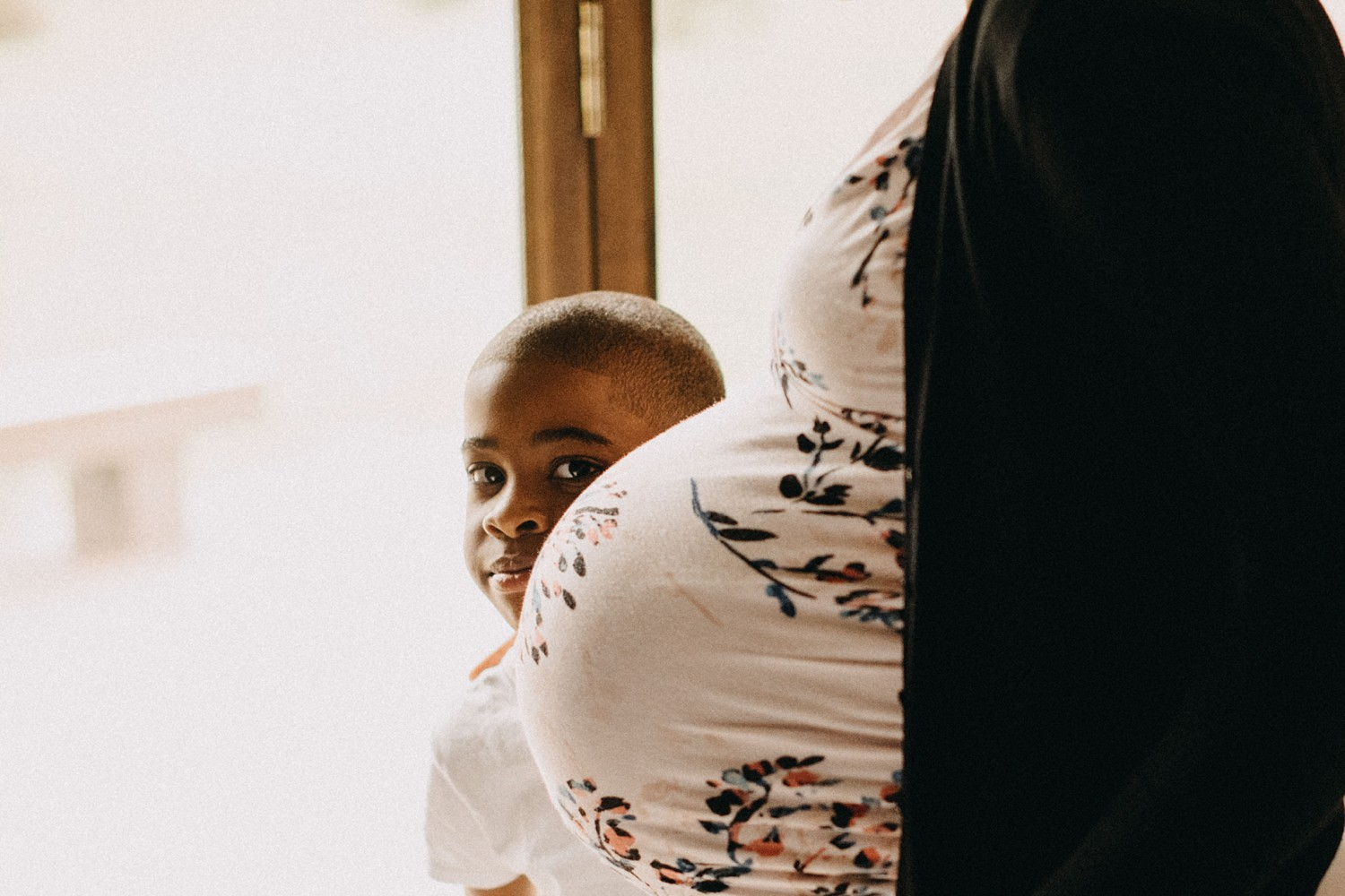 This is  Marcus , our firstborn son standing behind his mommy's belly. Mason inside and was getting ready to come out.