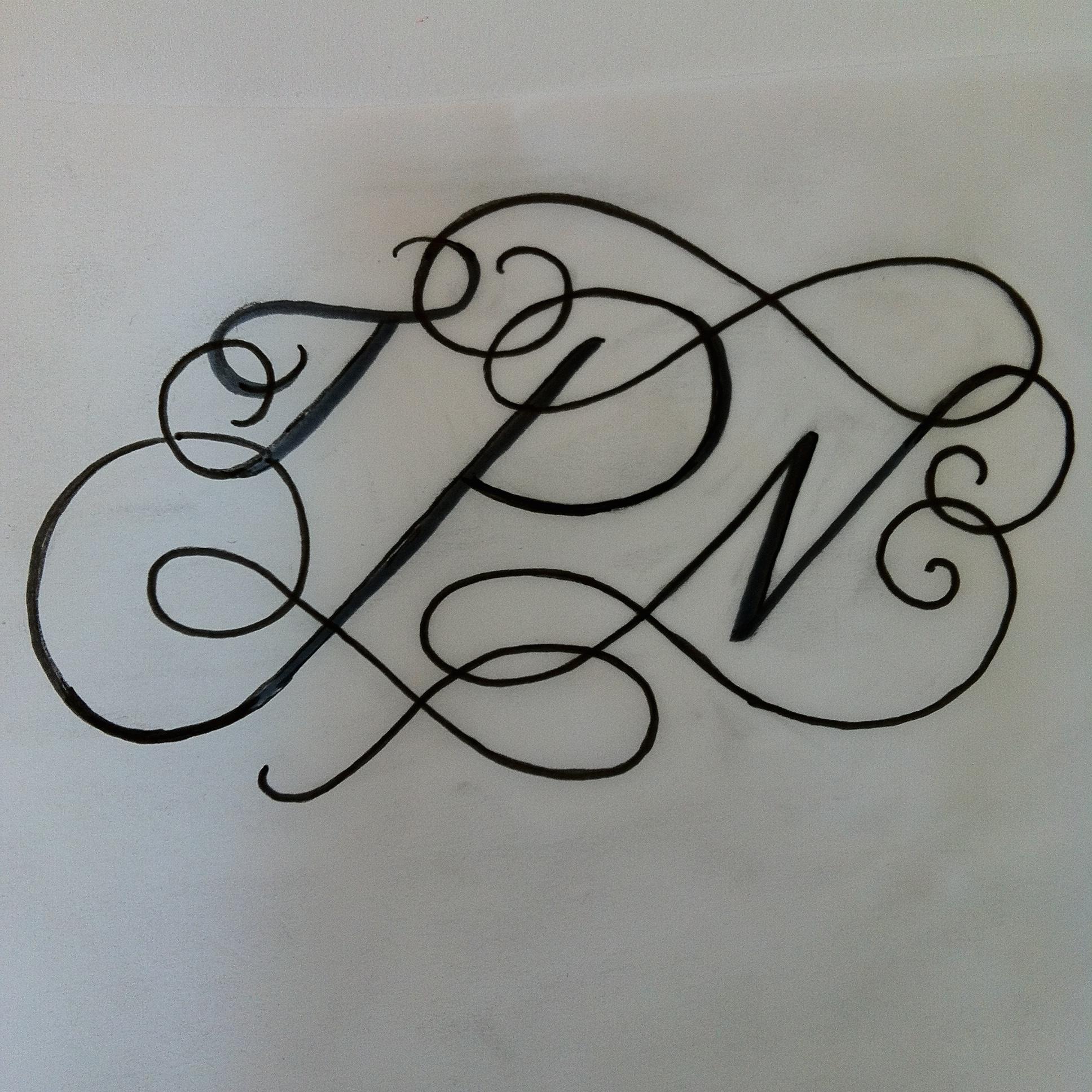 Original rough pen sketch of the monogram.