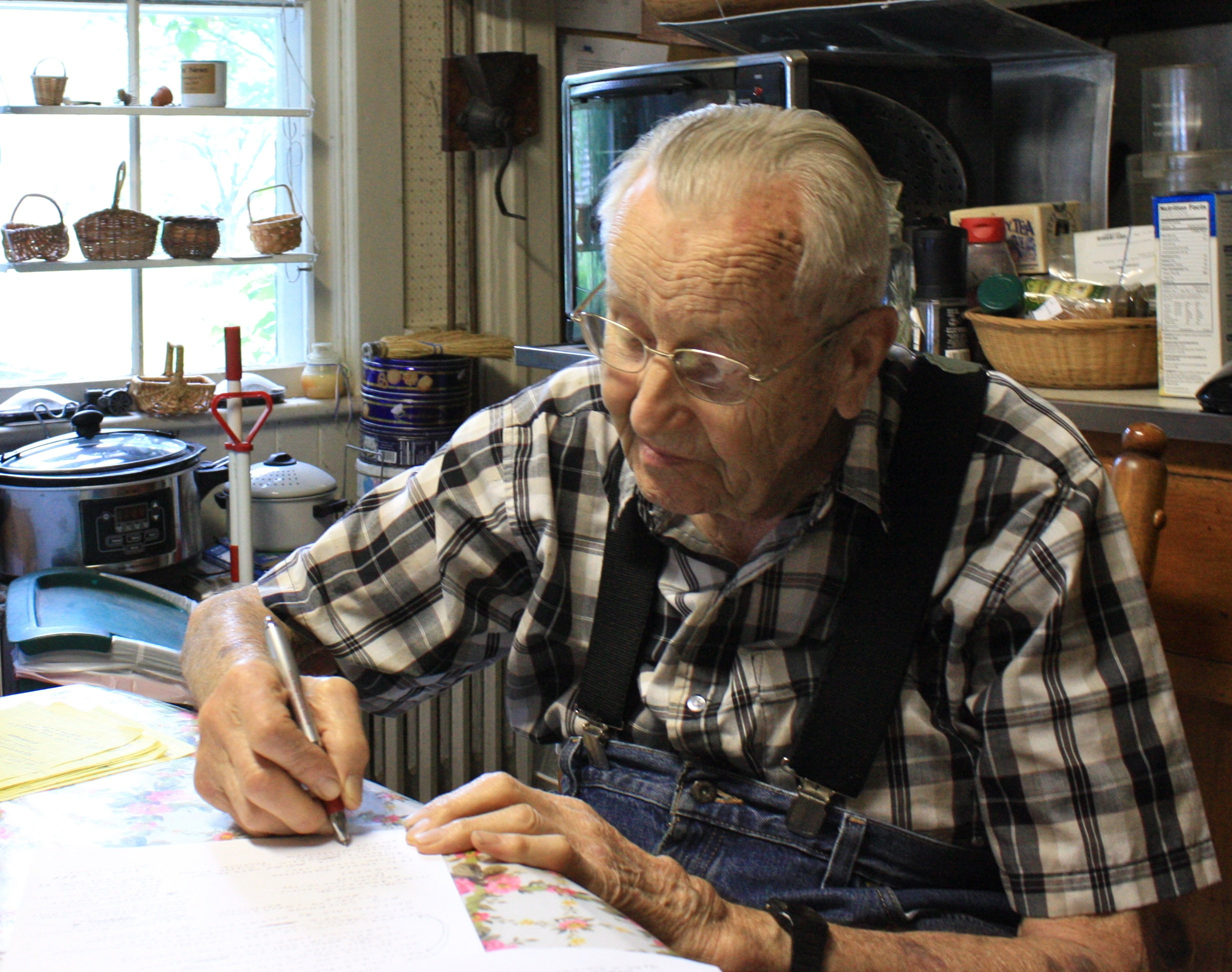 Everett Rau in his kitchen. June 2014.