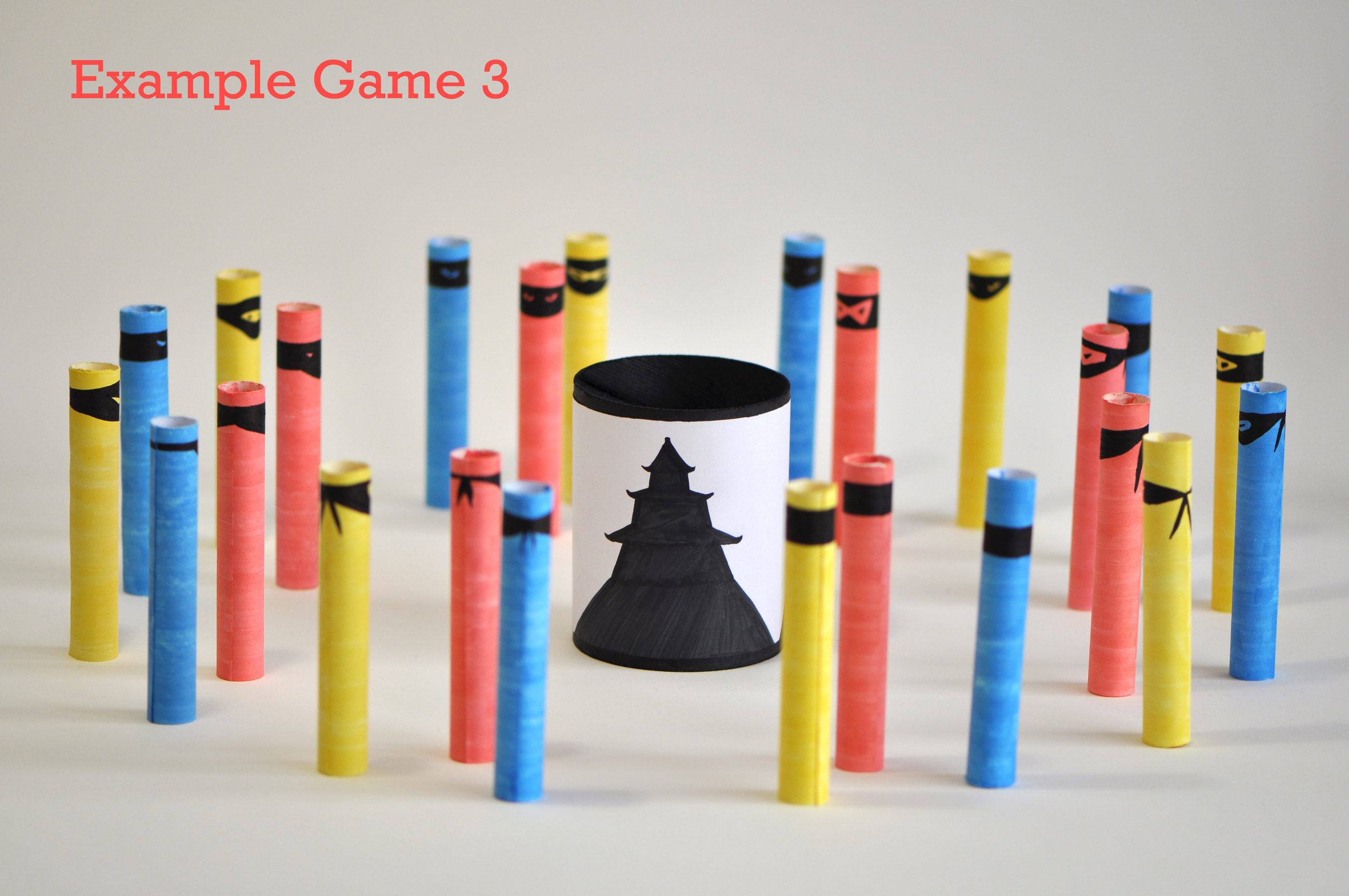 Two or more players (two players in this setup) each choose a color of ninjas and try to indirectly kill them by hitting the red ninjas first. The red ninjas are put back after being used each time. A player wins once all ninjas of the color he/she picked have been killed. The remaining players can continue until only one is left.