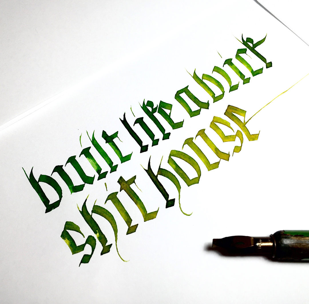 """Post number #3:  """"Built like a brick shit house"""" contribution from  Sarah Graham  while camping at The Prom (Australia) and trying to scare a wombat who showed up without an invite. Fraktur calligraphy using a Brause & Co 3mm nib and liquid watercolour ink."""
