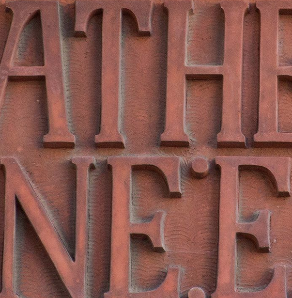 Leather Lane - Relief letters cut into a terracotta panel dates to the 1930s (when the building was re-modelled)