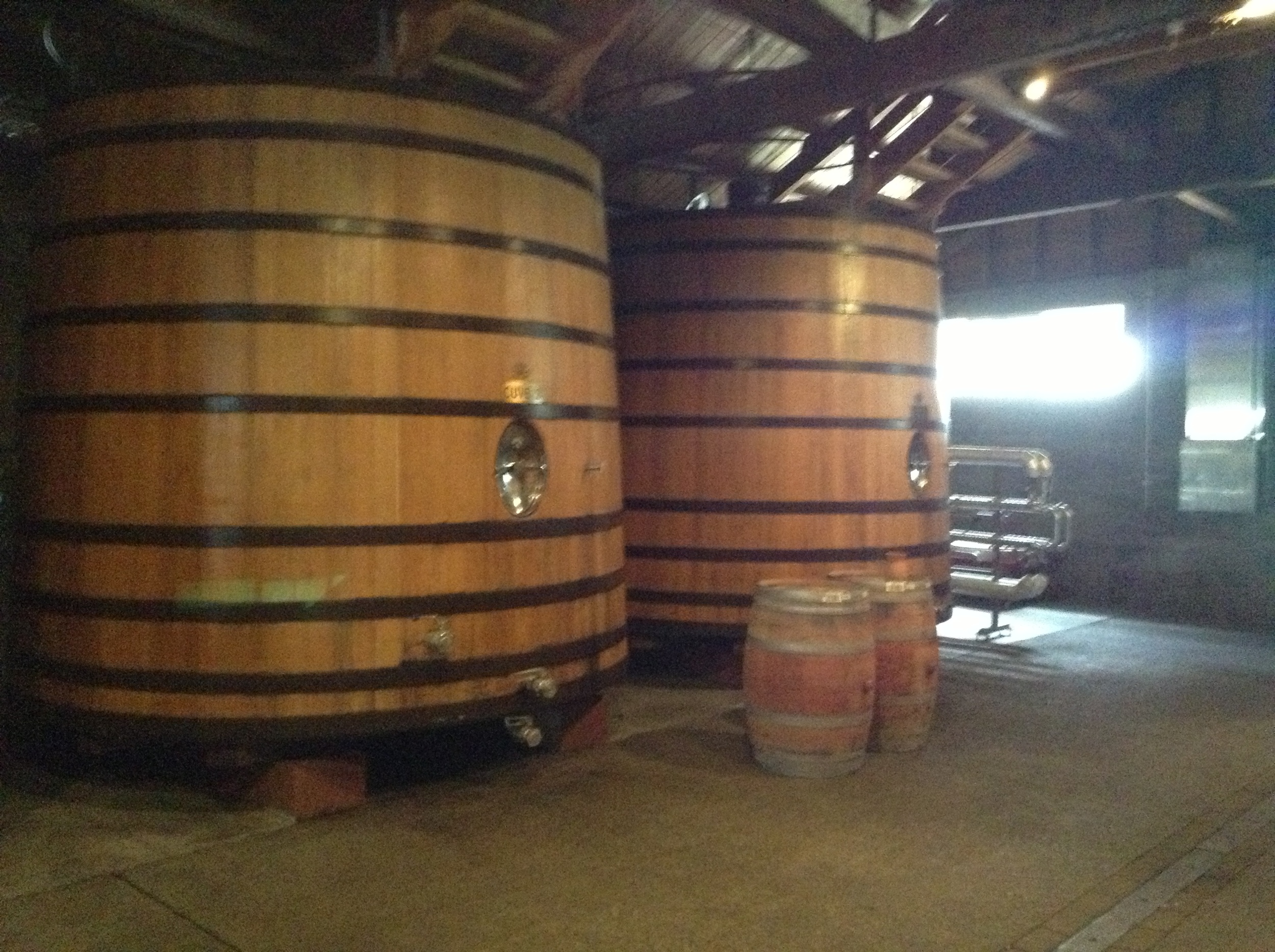 18,000 litre Cuves with barrels set up for the tasting after the tour.