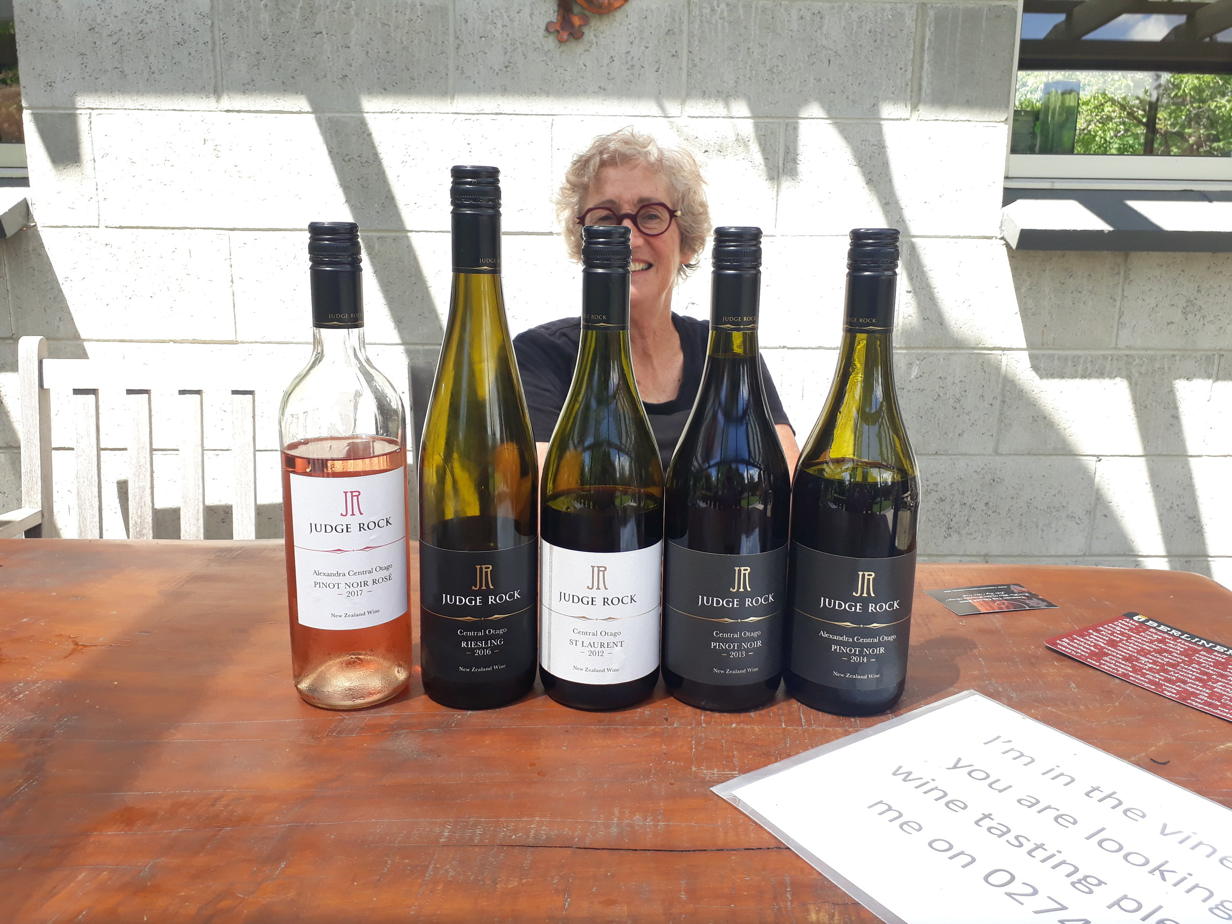 Angela Jacobson partially obscured as she talks through Judge Rock's range of wines.