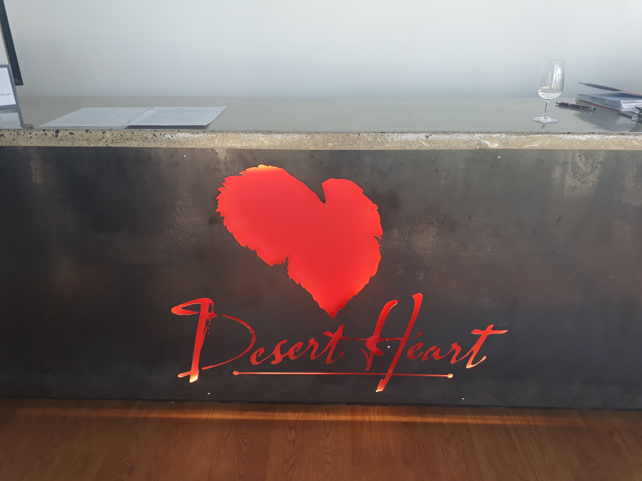Desert Heart's iconic logo represents both a heart, as well as the shape & colour of a grape leaf in autumn.