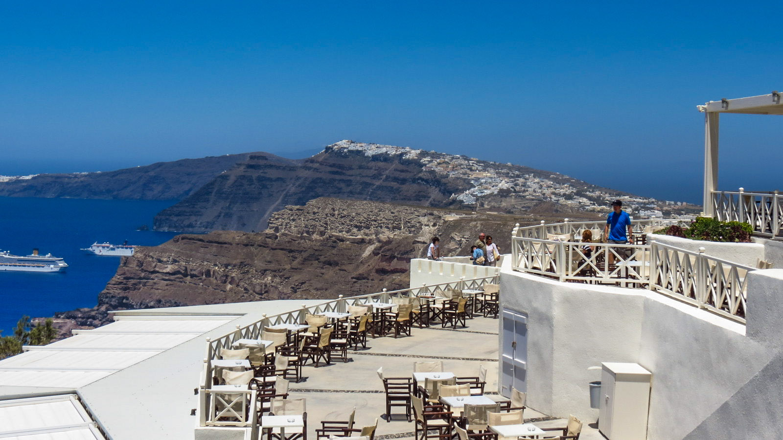 The view across the Island with views of Fira from  Santo Wines . Several cruise ships are moored in the lagoon below. Photo cred:  Flashpackatforty