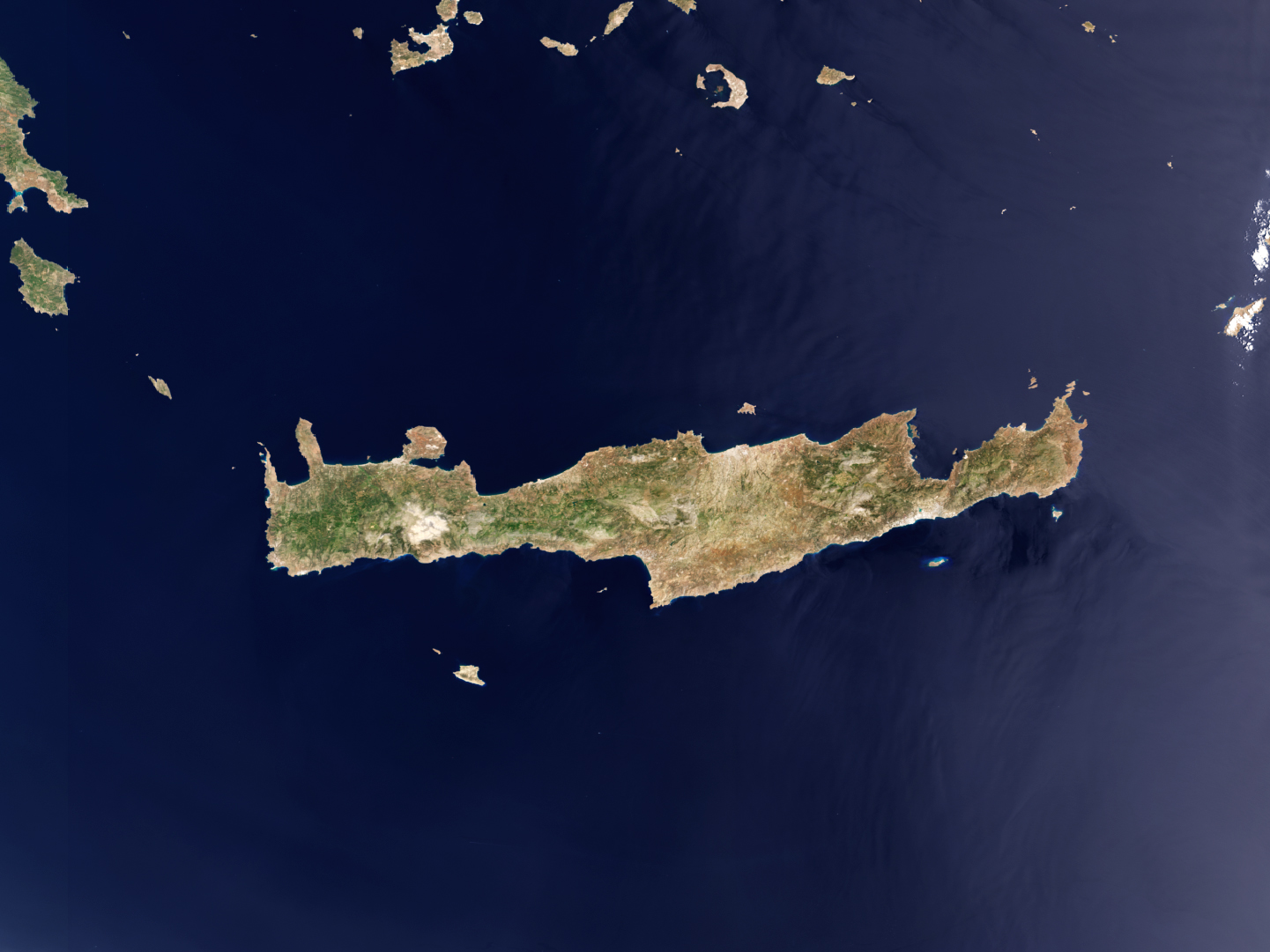Satellite imagery of Crete, shows that much of the island is rugged, dry and mountainous, with much of the vineyards located in the centre-east, the widest north-south portion of the region.