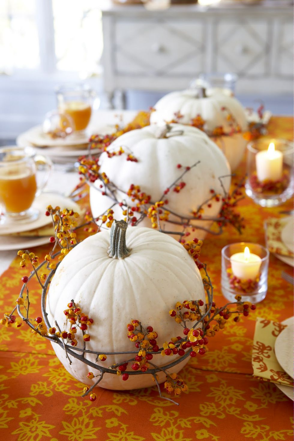 fall-centerpieces-white-pumpkin-berry-centerpiece-1529617162 2.jpg