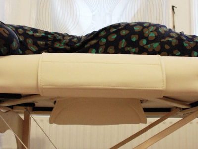 Pregnant women are able to lay tummy-down on this specially designed table.