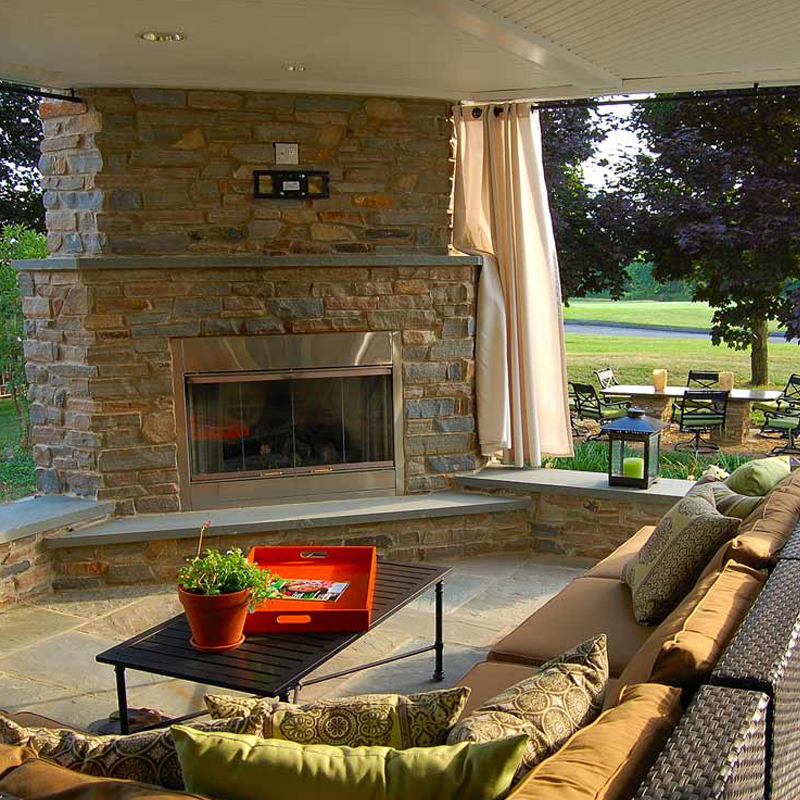 Lancaster Pa. flagstone patio, traditional fountain, outdoor fireplace, lush planting.