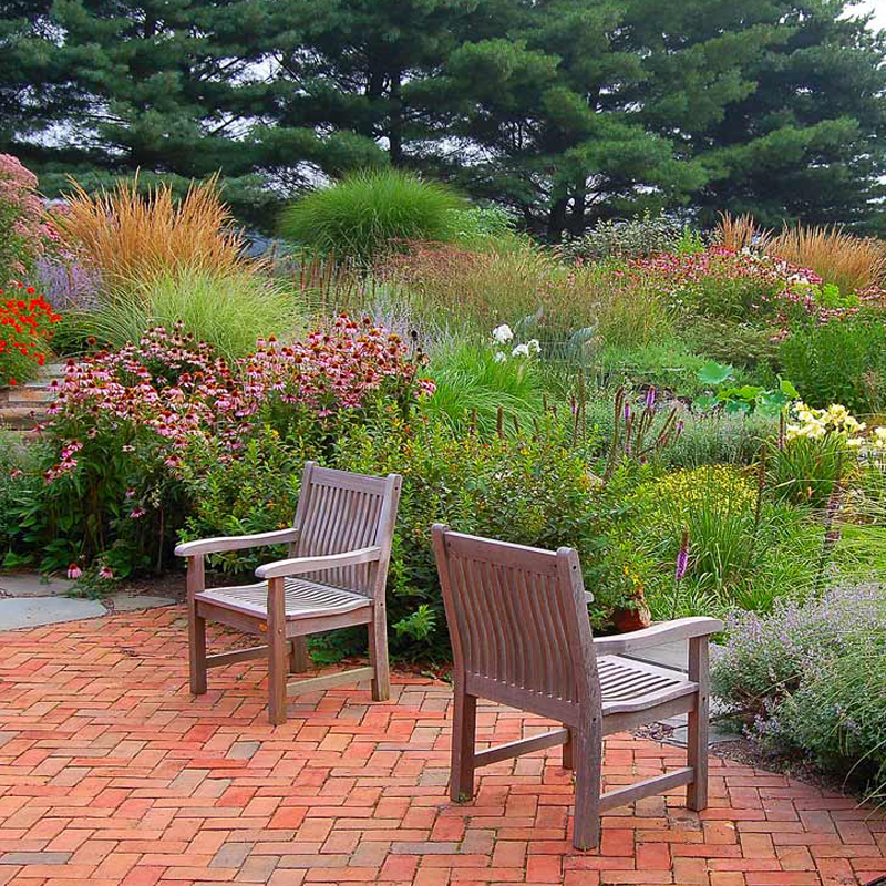 Perennial gardens in Lancaster Pa. Natural water feature, Koi pond.